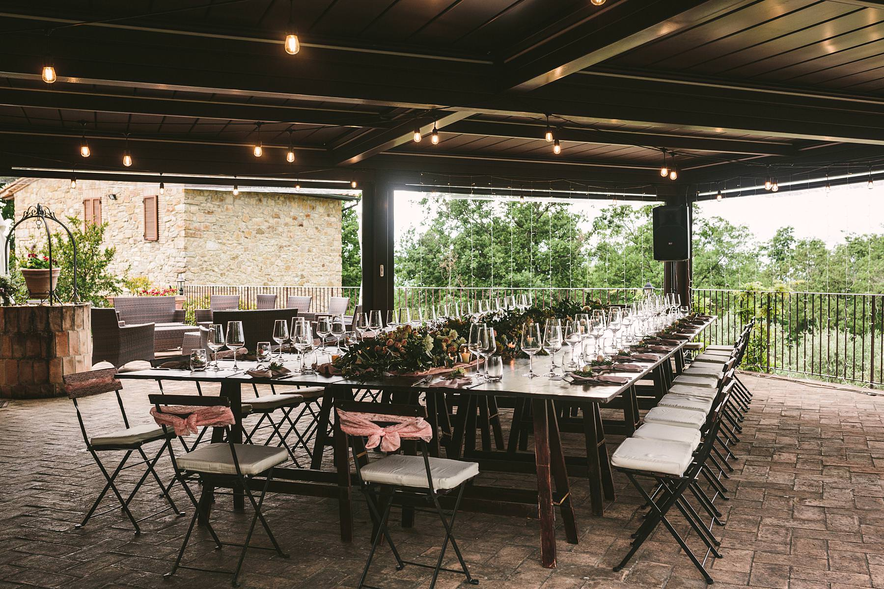 Lovely indoor wedding dinner decor table at Villa Le Bolli venue near Radicondoli in Tuscany countryside