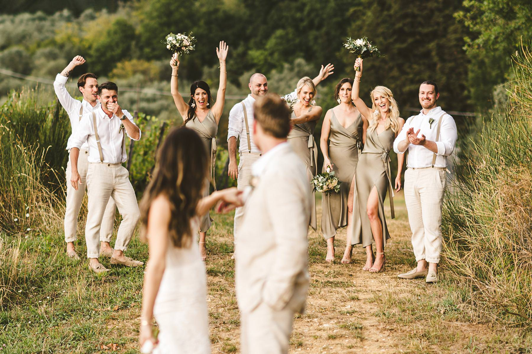 Unforgettable wedding party group candid shoot in the countryside of Chianti in Tuscany near the historic residence of Villa Il Poggiale