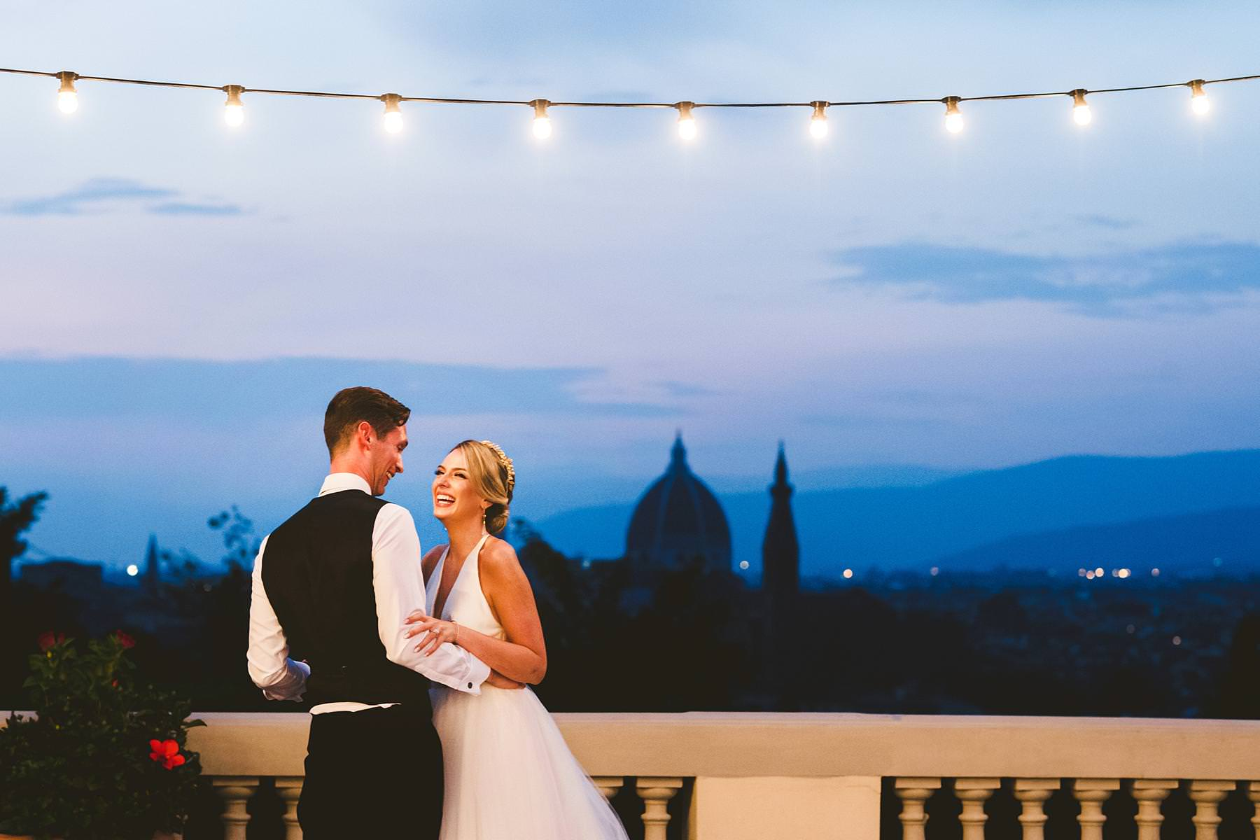Bride and groom unforgettable first dance with a spectacular view of Florence at Villa La Vedetta. Luxury intimate wedding