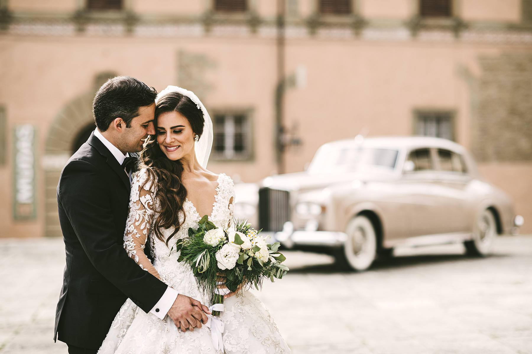Romantic and elegant wedding portrait in Tuscany near the Cathedral of Arezzo