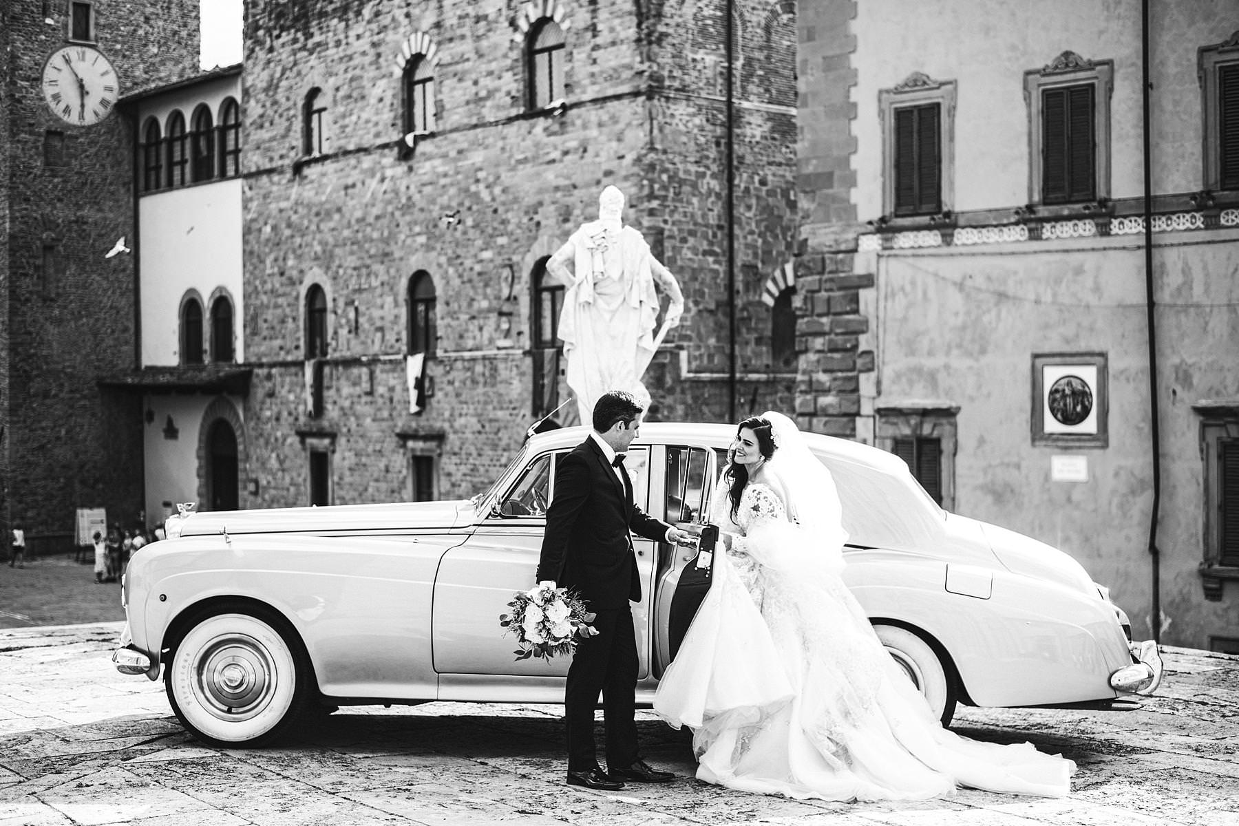 Lovely moment by the bride and groom near the Arezzo Cathedral. Elegant destination wedding in Tuscany with reception at Valenzano Castle