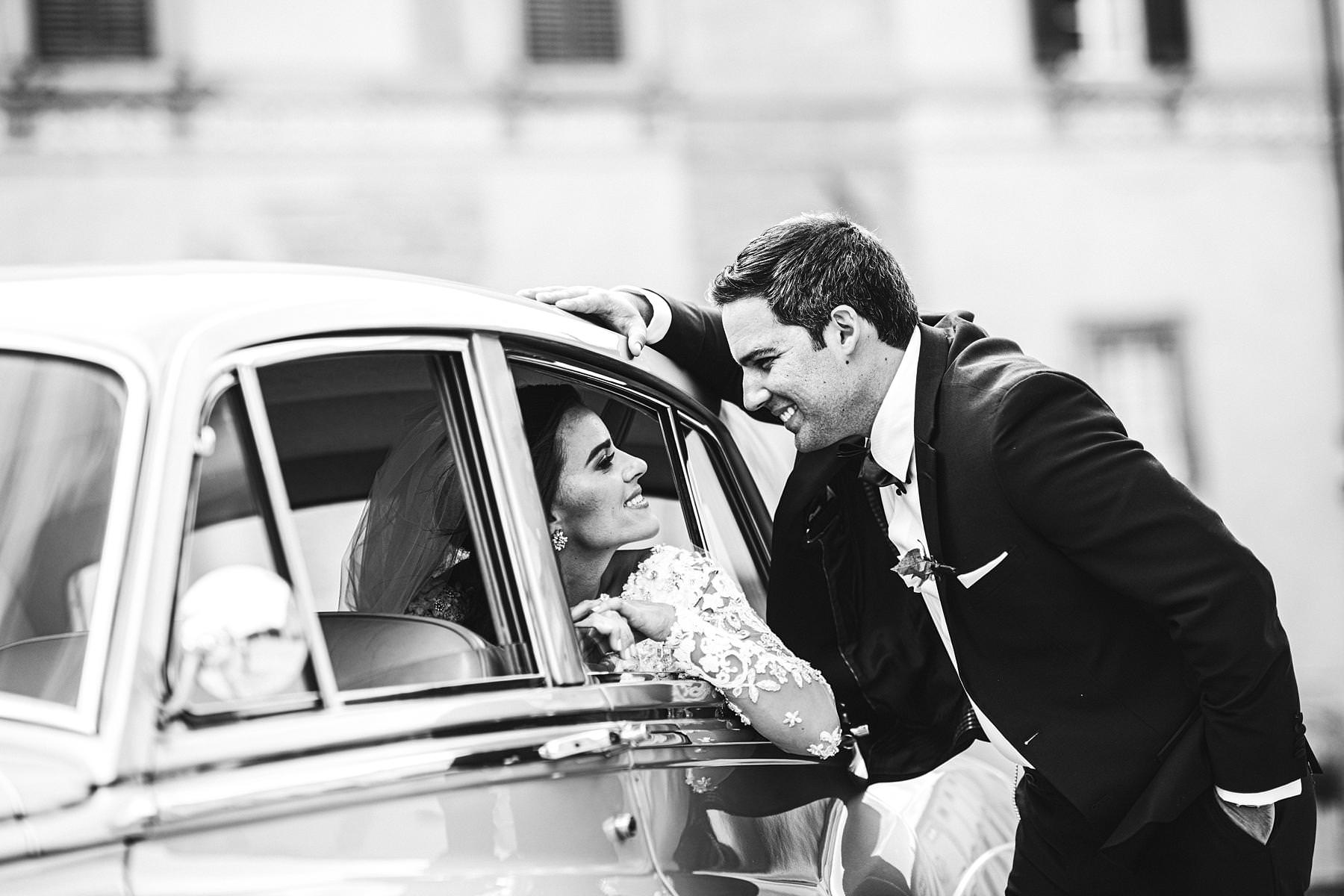 Elegant bride and groom portrait in Arezzo town. Destination wedding in Tuscany with reception at Valenzano Castle