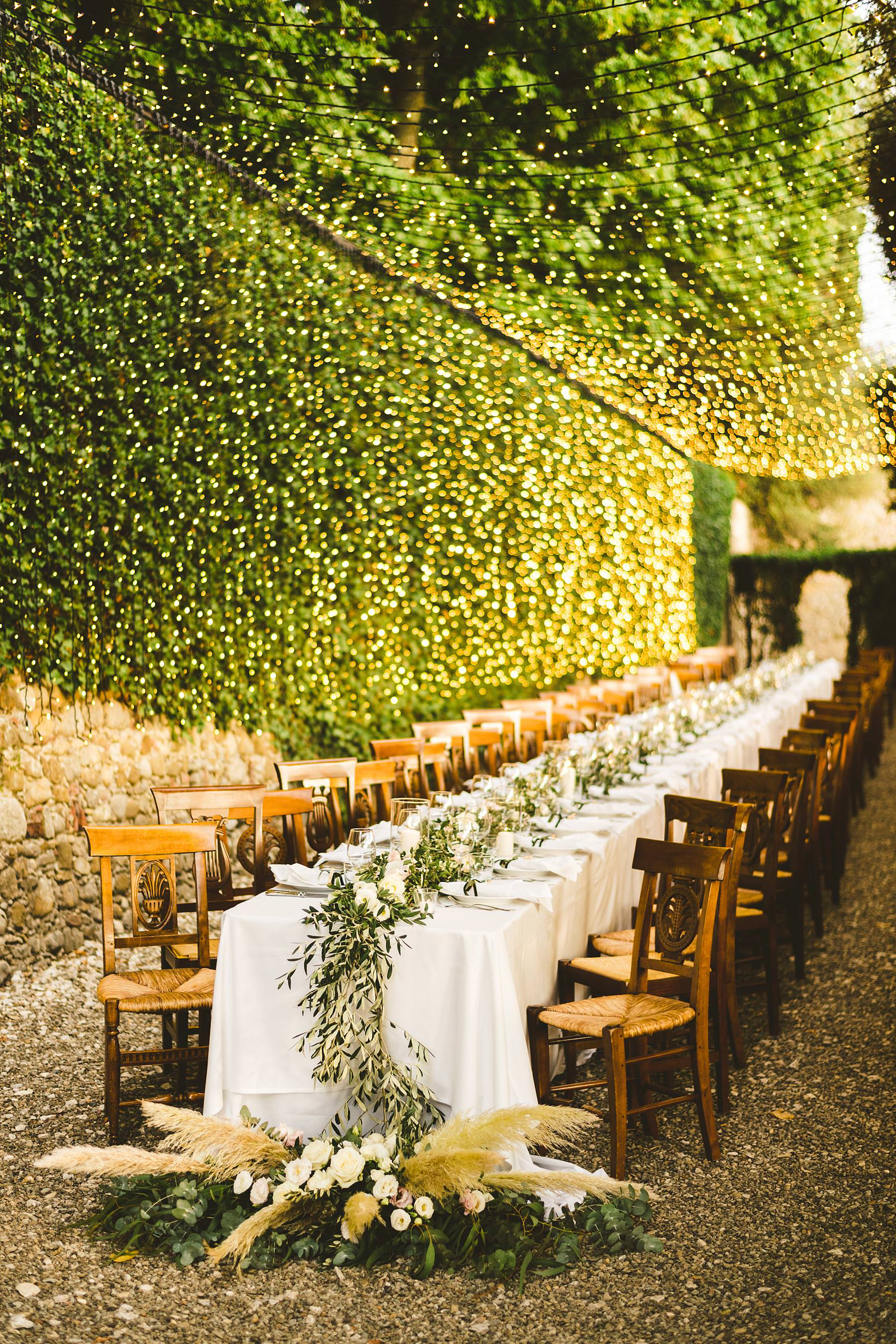Incredible care of every details for this imperial table outdoor dinner decor at the historic residence of Villa Il Poggiale in the heart of Chianti, Tuscany