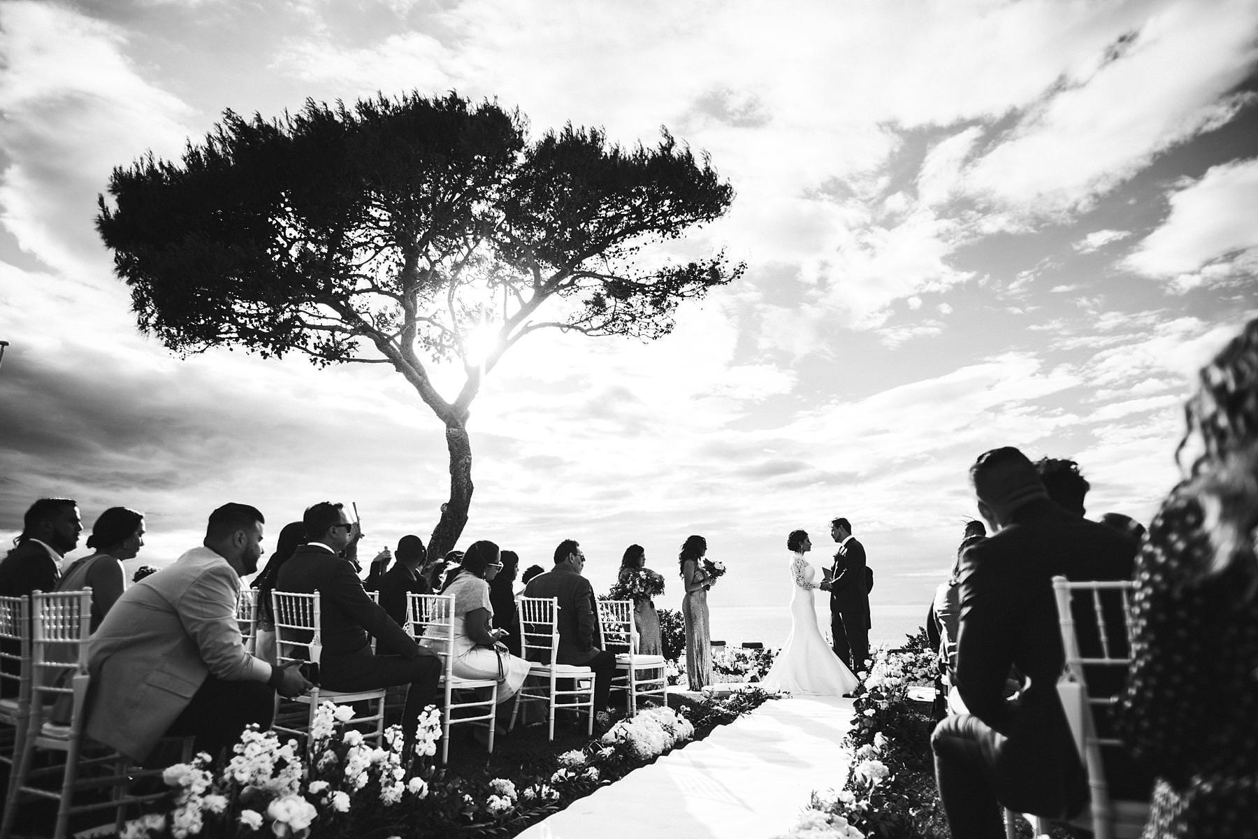 Emotional and elegant outdoor destination wedding ceremony at amazing Villa Angelina terrace in Sorrento