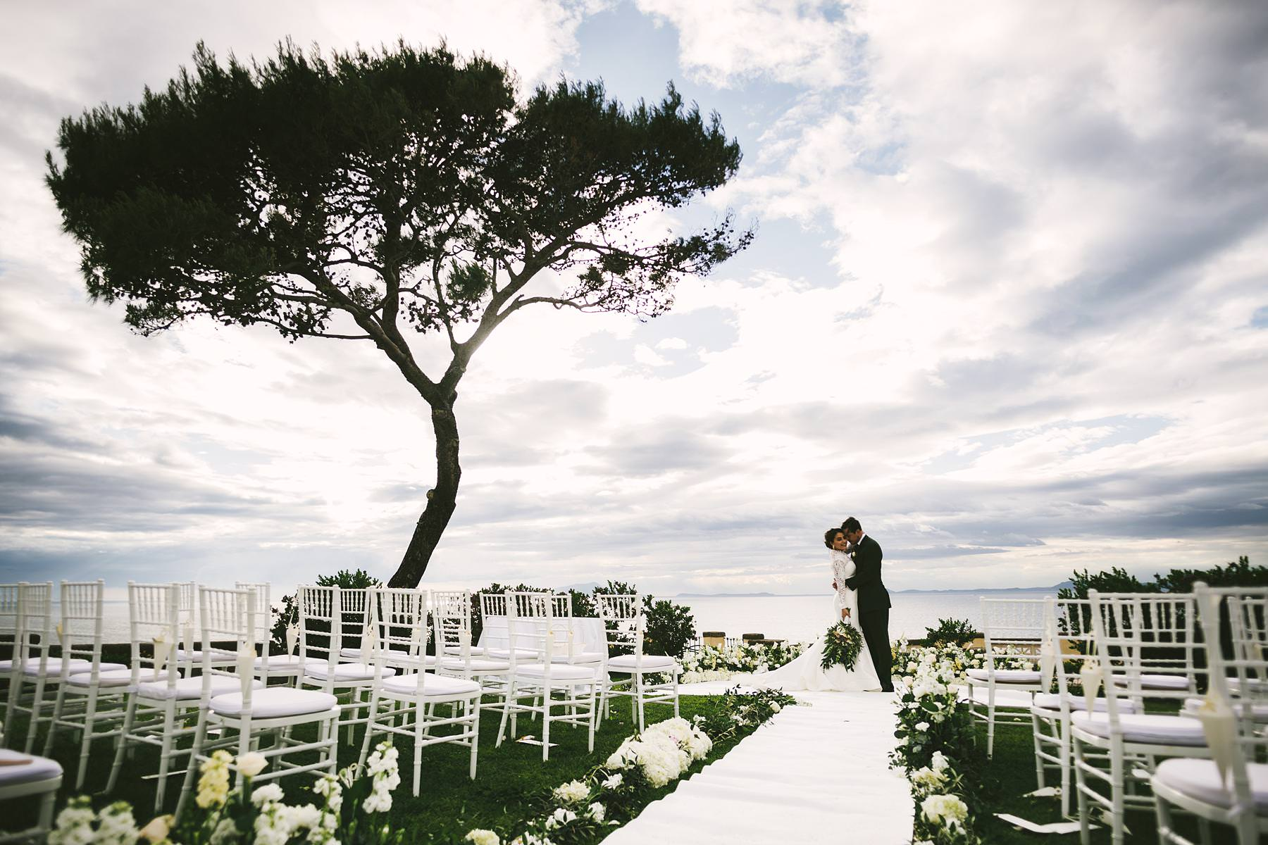 Amazing bride and groom wedding portrait in Sorrento at Villa Angelina. The amazing terrace of the villa is the perfect location for the outdoor ceremony and portrait session
