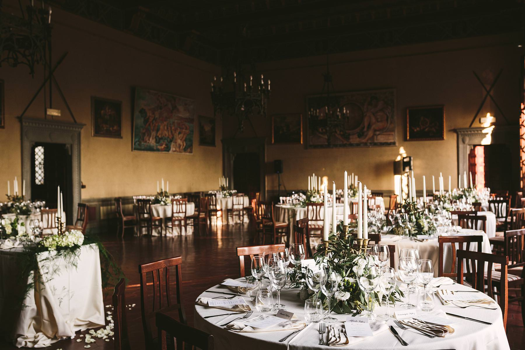 Lovely and elegant dinner decor at Valenzano Castle wedding near Arezzo in the Tuscany countryside