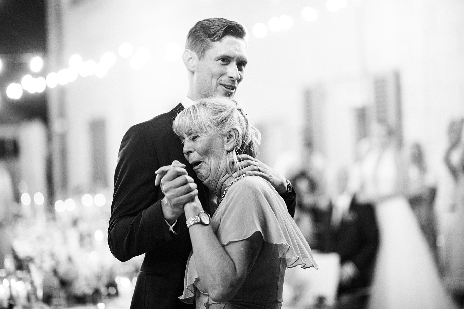 Intimate luxury destination wedding in Florence at Villa La vedetta. Lovely moment during groom and mother dance