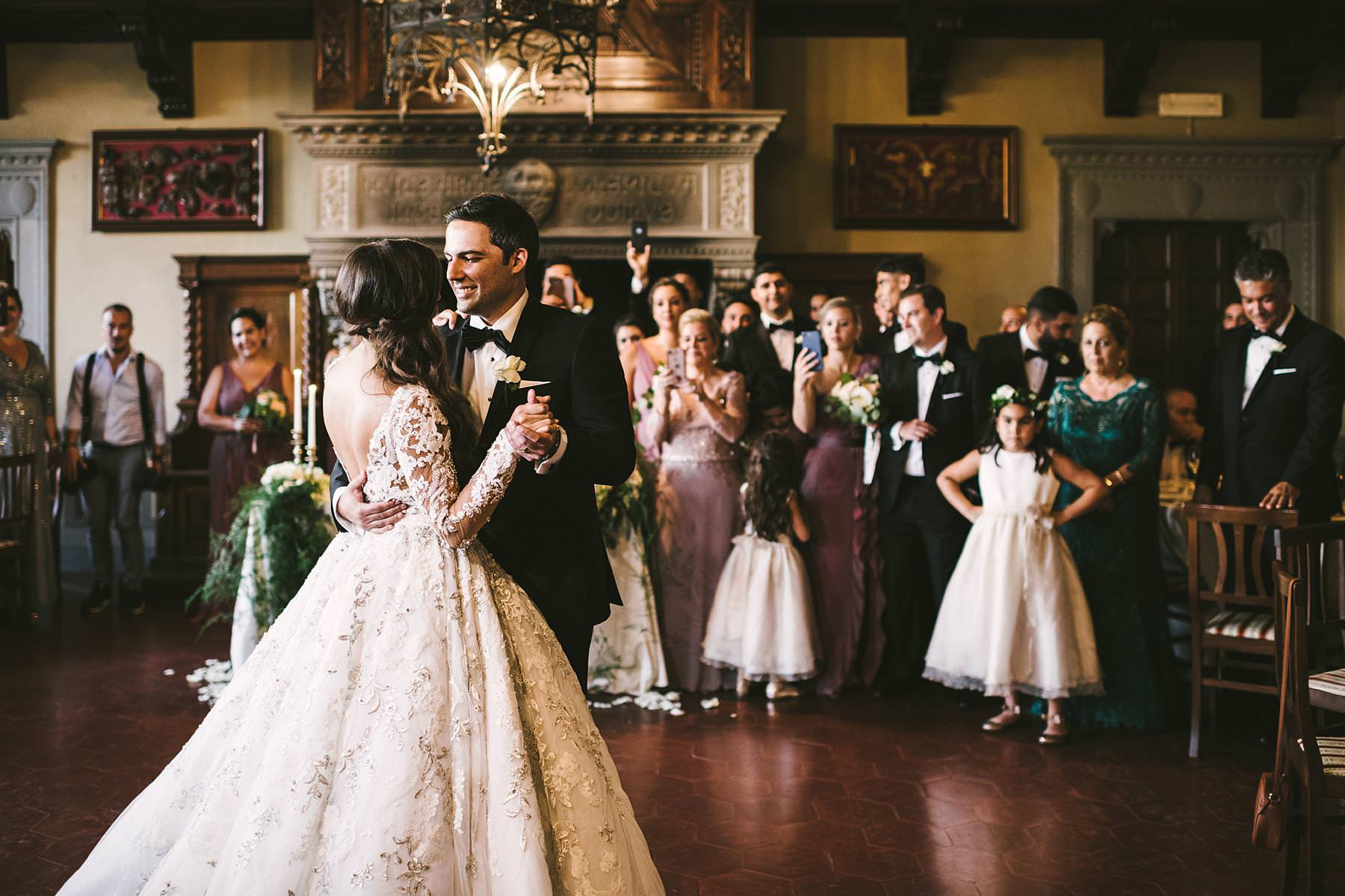 Bride and groom emotional first dance at Valenzano Castle in Tuscany near Arezzo. Destination wedding in Italy
