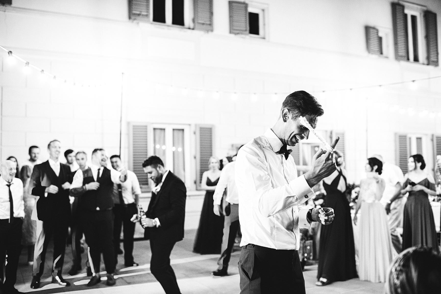 Groom and mens got fun at the wedding party in Villa La Vedetta, Florence