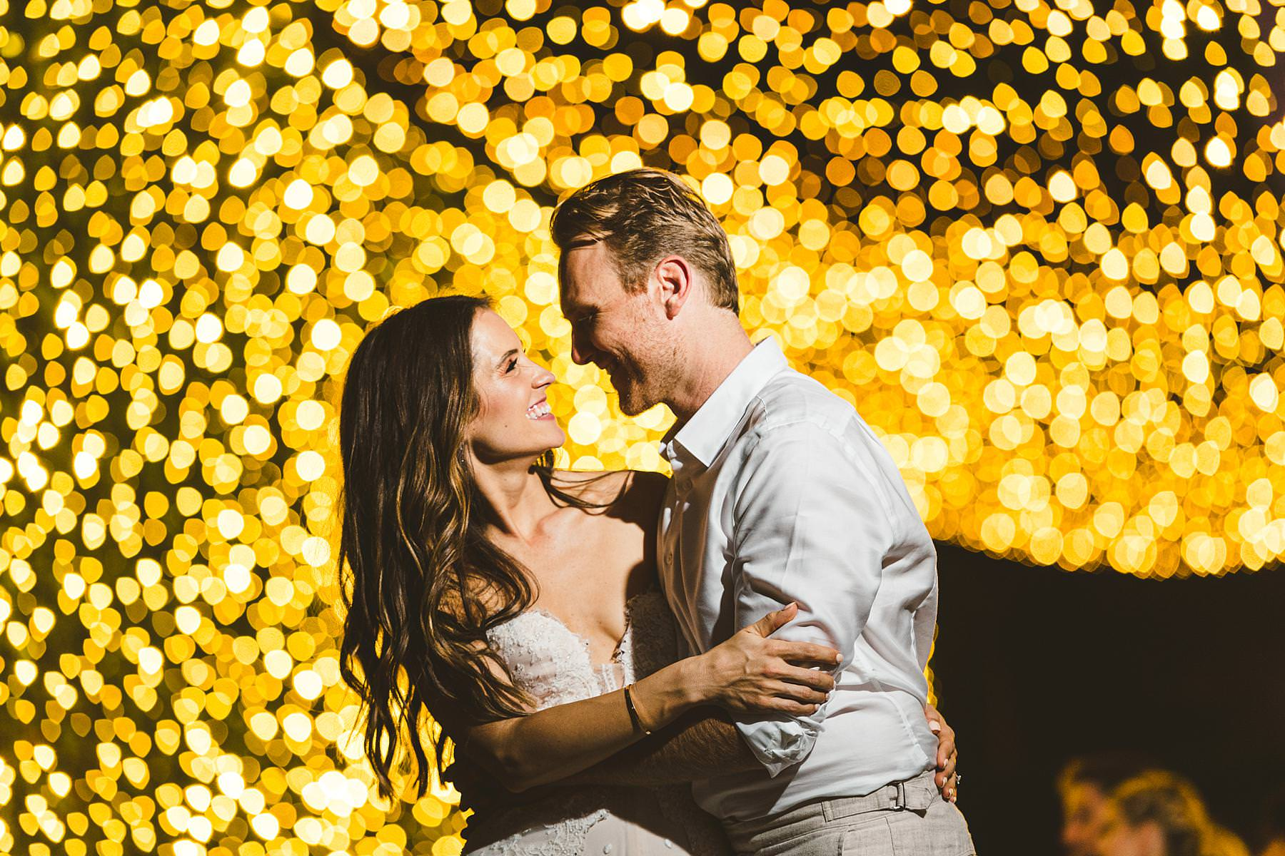 Creative and modern bride and groom wedding portrait with lots of tini shining lights at Villa Il Poggiale, Chianti, Tuscany