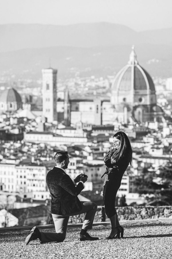 Lovely and unforgettable real surprise proposal photo session in Florence at San Miniato al Monte near Piazzale michelangelo with breathtaking view of Florence as background