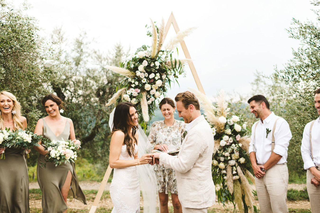 Modern and unusual wedding framed by the olive groves of Chianti. Intimate romantic and elegant destination wedding in Tuscany at historic residence of Villa Il Poggiale