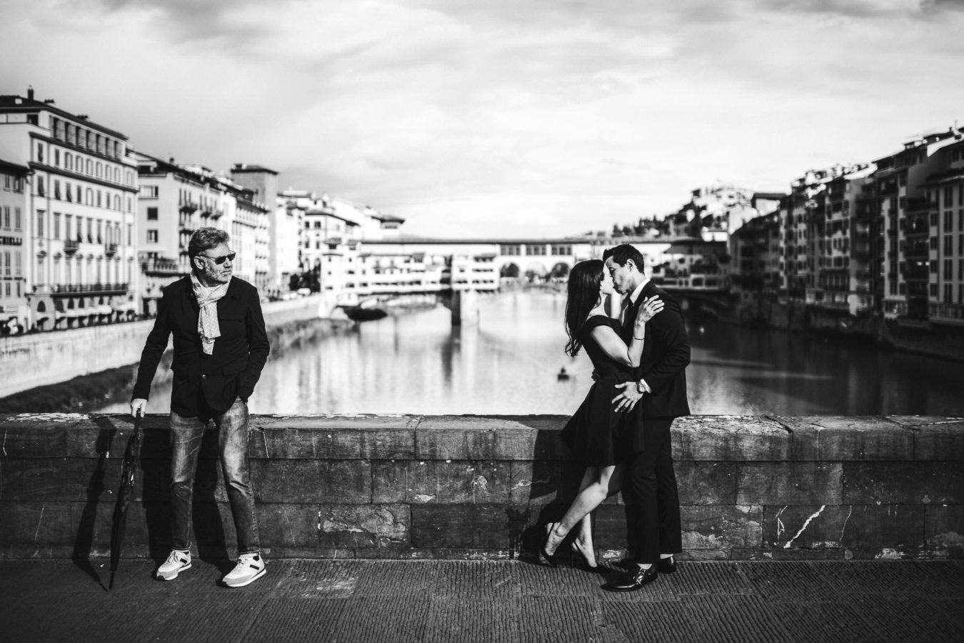 Stylish, candid and elegant photo in Florence at Ponte Vecchio in the very heart of Florence