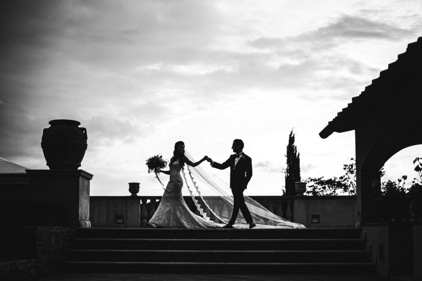 Elegant and charming wedding photo. La Dolce Vita style destination wedding in Italy at historic estate of Villa La Selva Wine Resort located in the heart of Tuscany countryside
