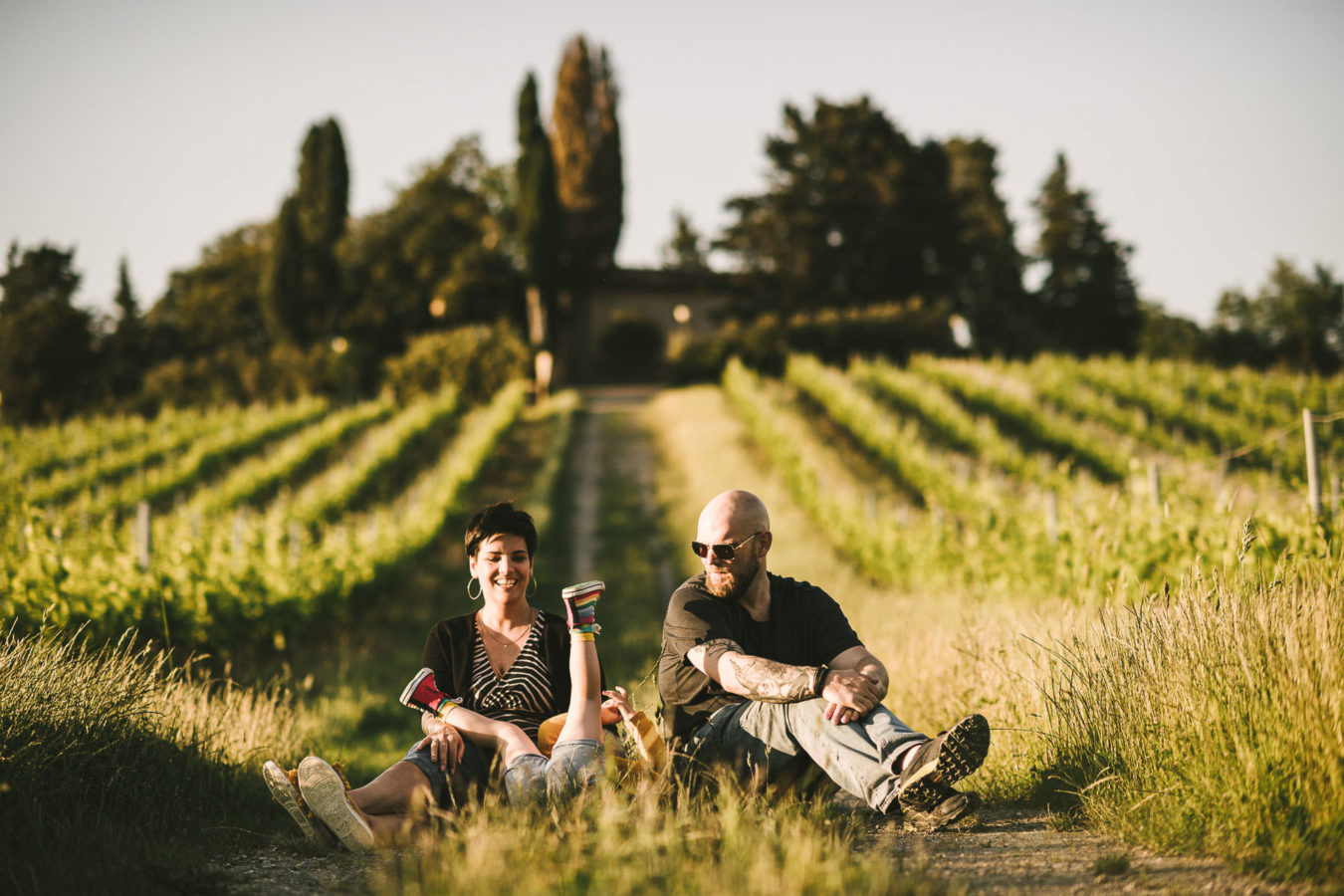 Exciting and funny family photo shoot in Tuscany countryside of historical town of Peccioli
