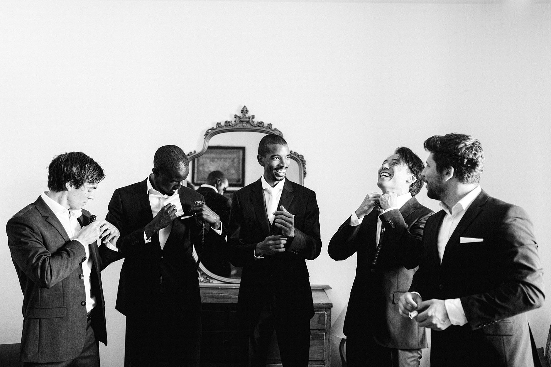Groom Tanaka's getting ready with groomsmen at Montelucci Country Resort historic residence. Destination wedding in Tuscany between Chianti and Valdarno