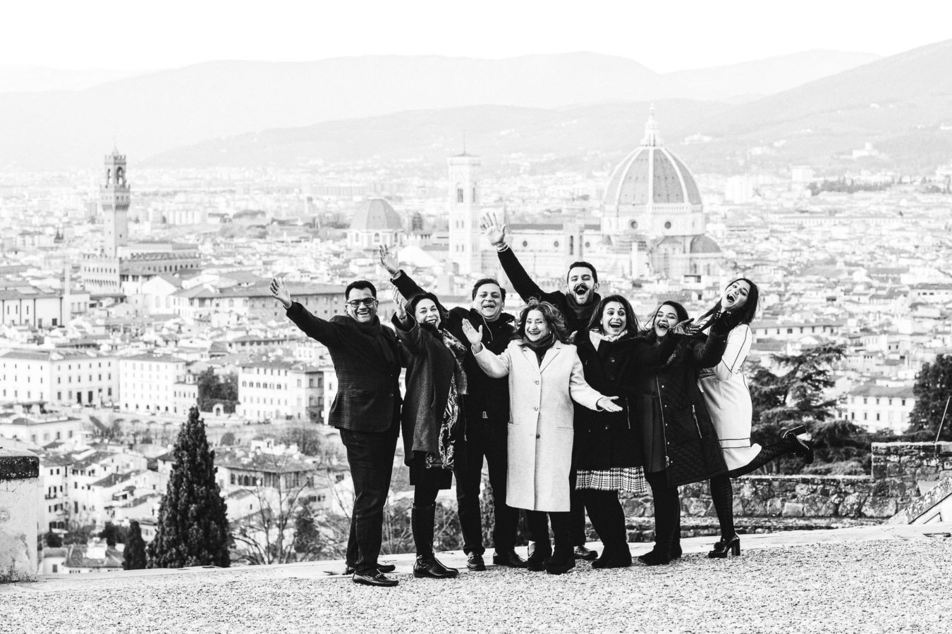 Exciting winter family reunion in Florence at San Miniato al Monte near Piazzale Michelangelo with breathtaking view of the city as background