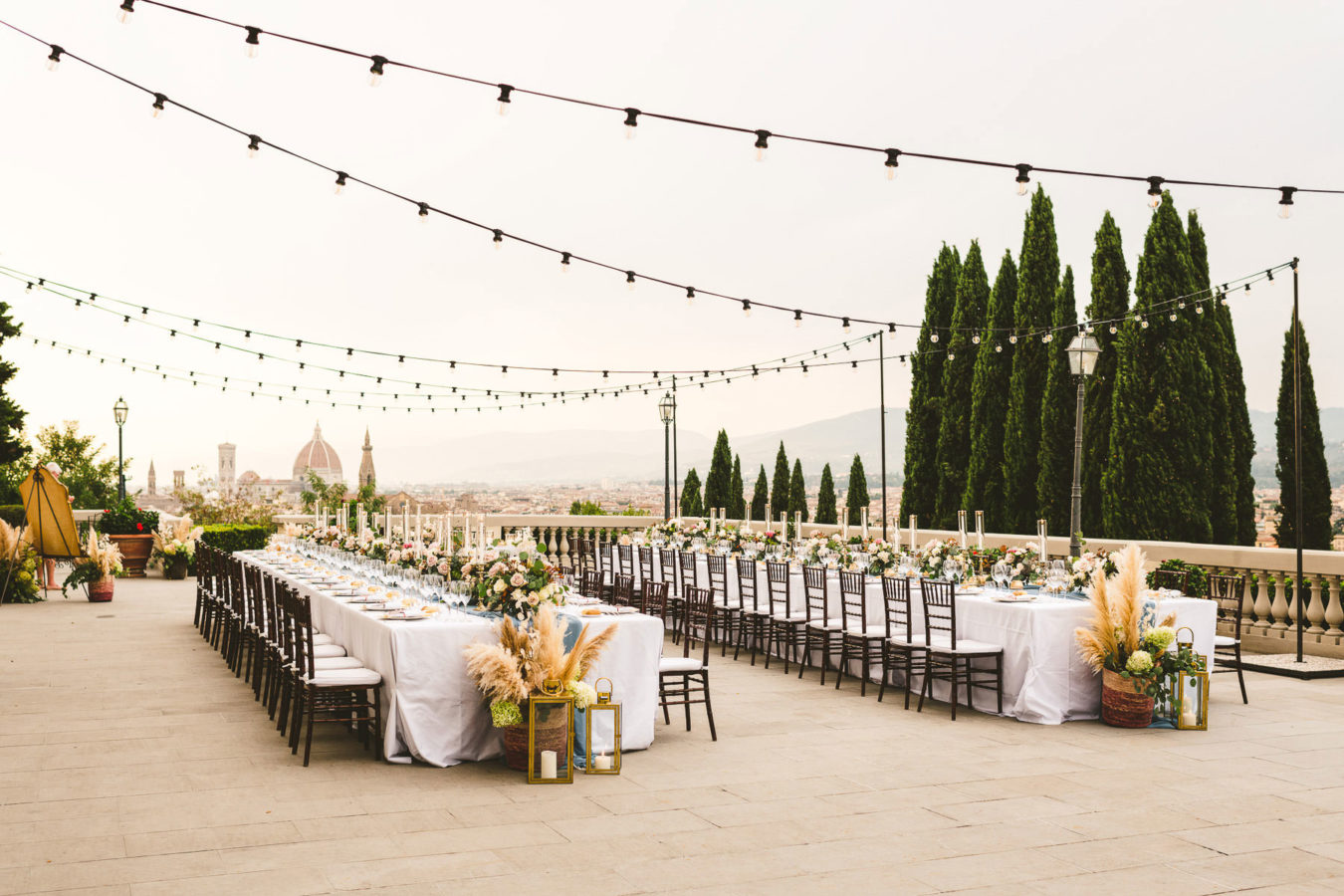 Luxury wedding with amazing view at Villa La Vedetta in Florence. Intimate luxury destination wedding dinner decoration by Stiatti Fiori and Villa La Vedetta. Every details was spotless and delightful, contributing to creating the luxury wedding bride and