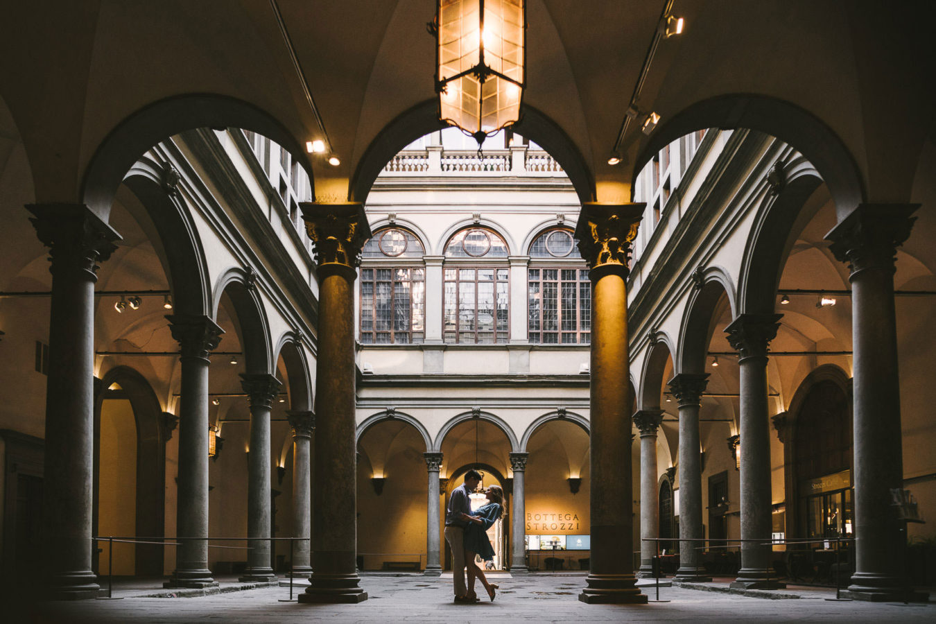 Lovely and elegant engagement photo at sunrise early morning in Florence at Palazzo Strozzi