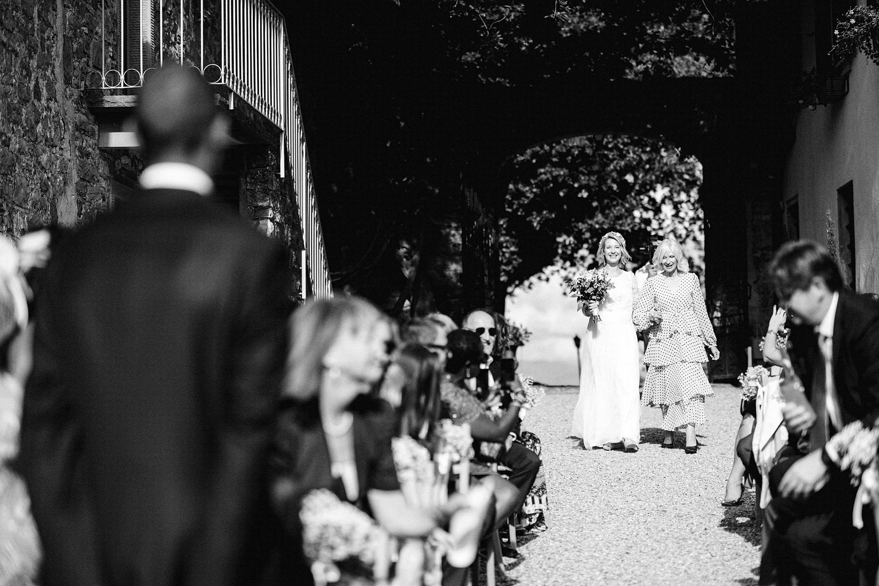 Lovely bride Isabella walks down the aisle with mom at Montelucci Country Resort wedding