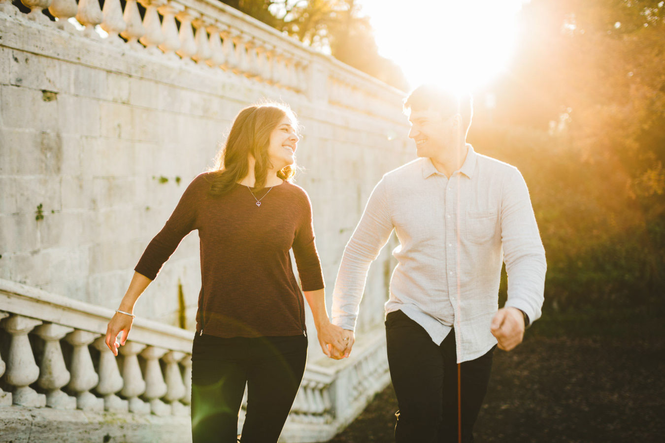 Exciting australian couple portrait candid photo in Florence San Miniato al Monte Golden hour