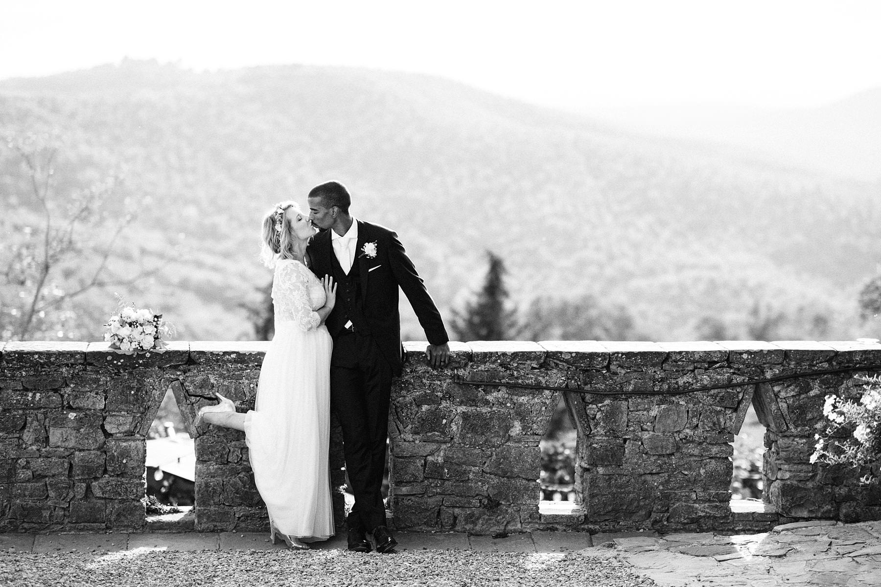 Lovely wedding portrait on a terrace overlooking rolling hills of the countryside of Tuscany at the historic residence of Montelucci Country Resort located between Chianti and Valdarno a perfect place for a destination wedding