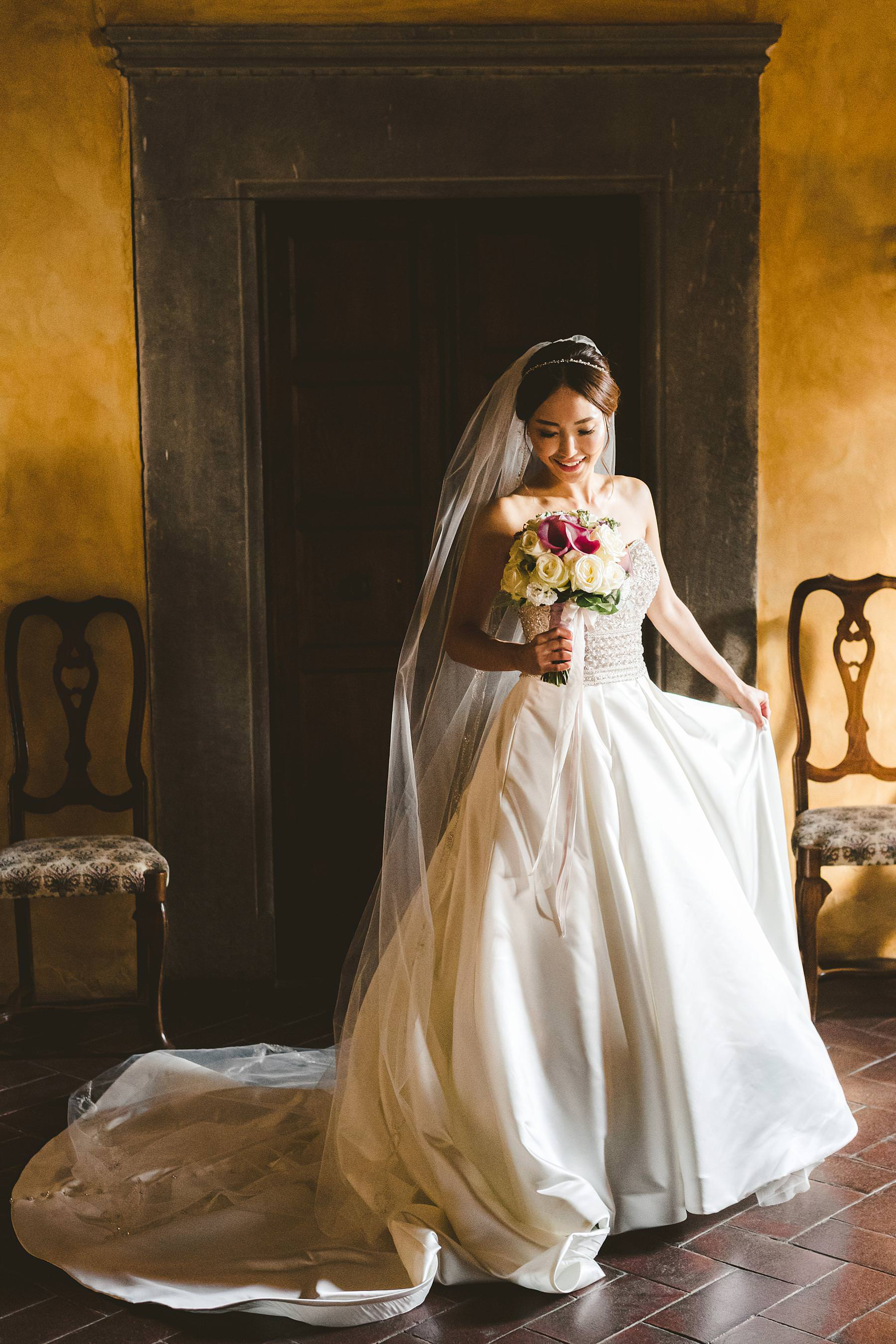 Beautiful bride Elise in Maggie Sottero wedding gown and her amazing cram and mauve bouquet by Jardin Divers. Intimate elegant destination wedding at Castello Il Palagio