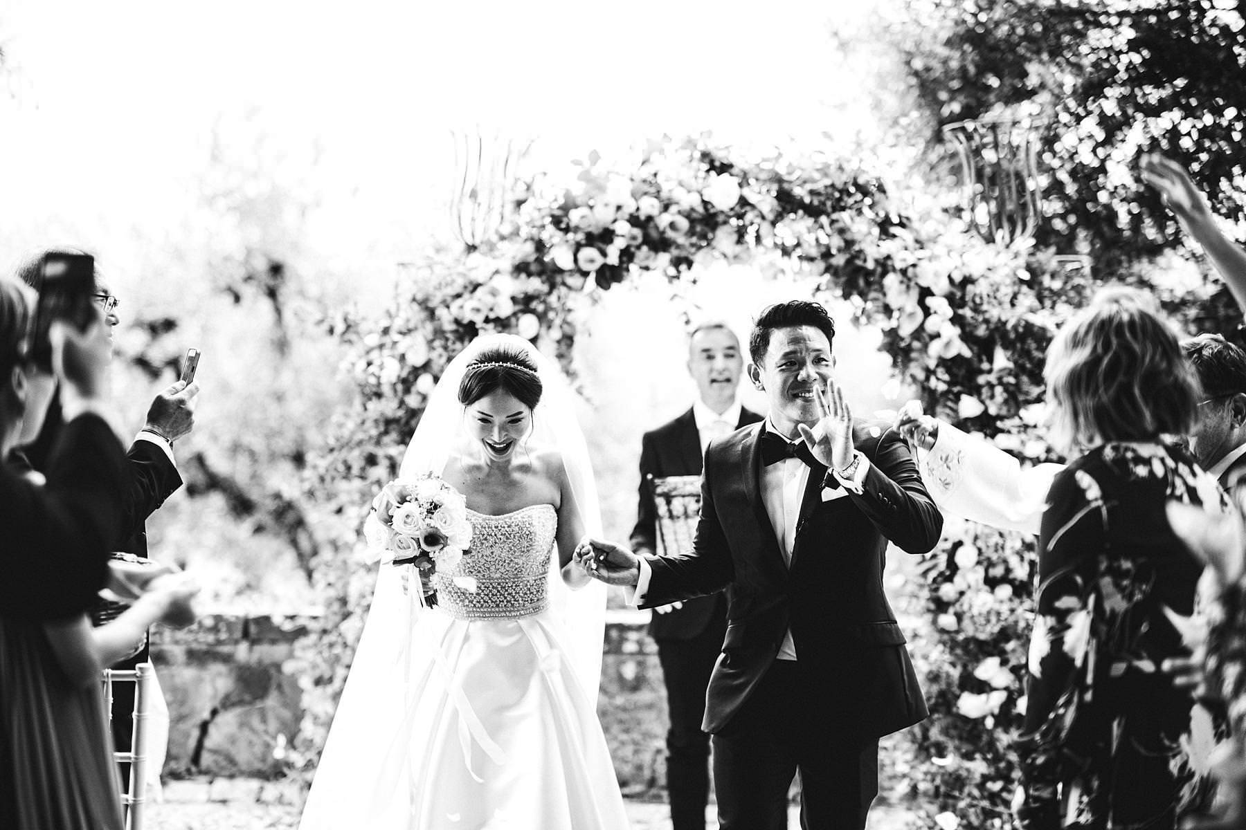 Lovely bride and groom moment during petal throwing at Castello Il Palagio in the countryside of Tuscany in Chianti