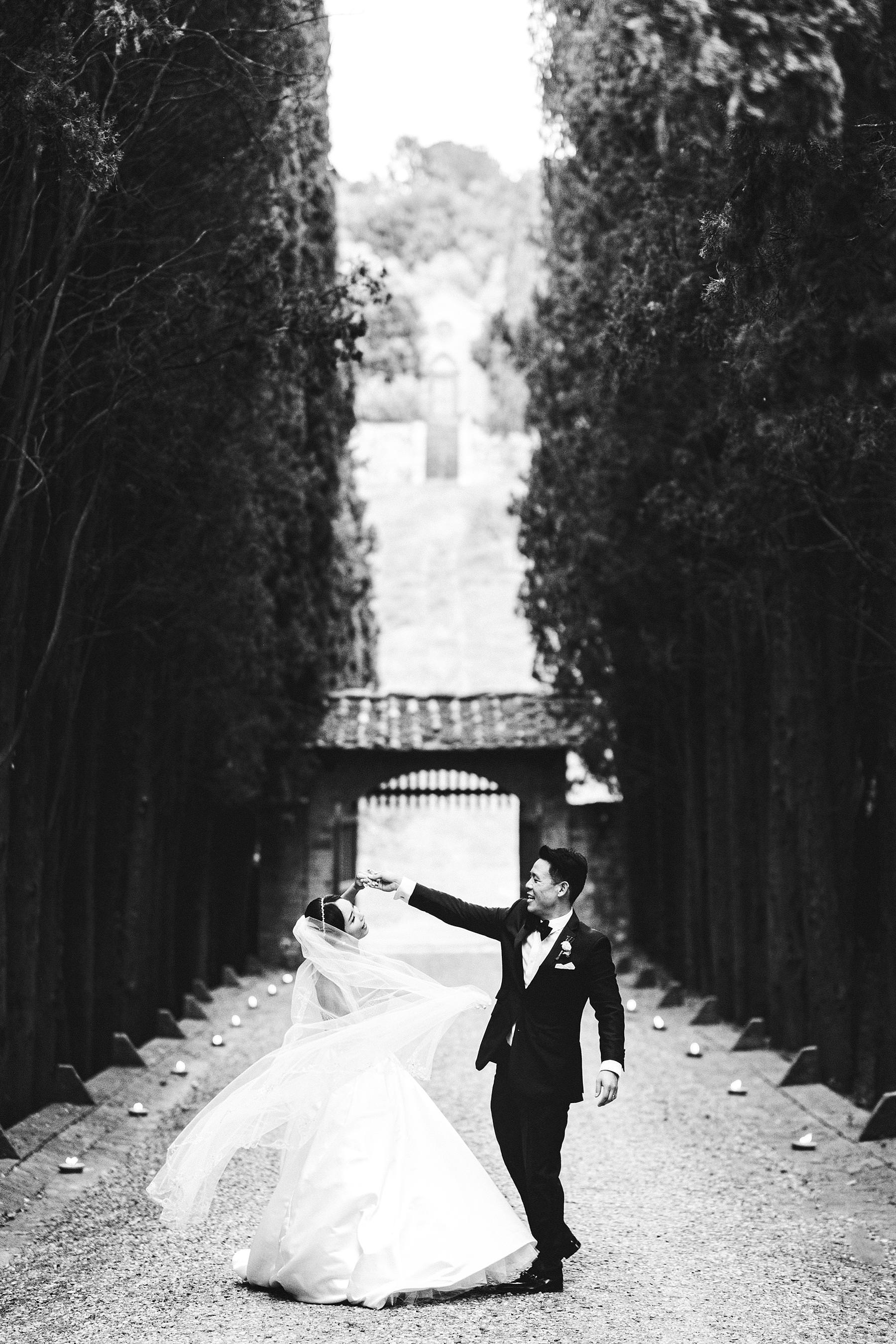 Lovely bride and groom wedding photo at Castello Il Palagio venue in the countryside of Tuscany near Chianti. Intimate castle wedding in Italy