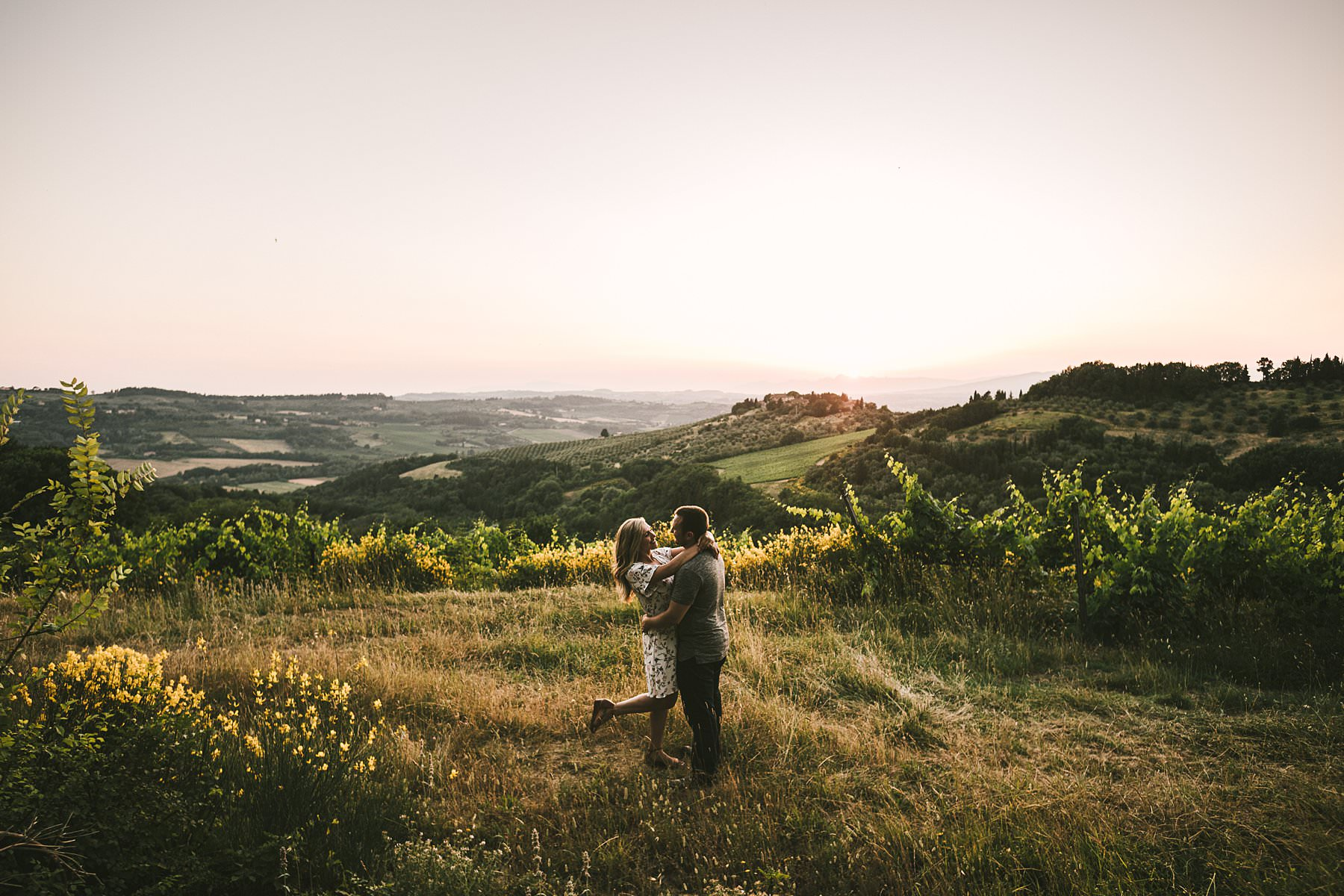 Delicate outdoor engagement photos in Tuscany: a holiday to remember. When you happen to visit a charming city like Florence and you've recently got engaged, there is only one thing you can do: get outdoor engagement photos taken in the best spots of the town and countryside. They will allow you to honor that precious moment and keep a never ending memory of a unique holiday. This is what brought Andrea and Aaron to contact me on a summer day…