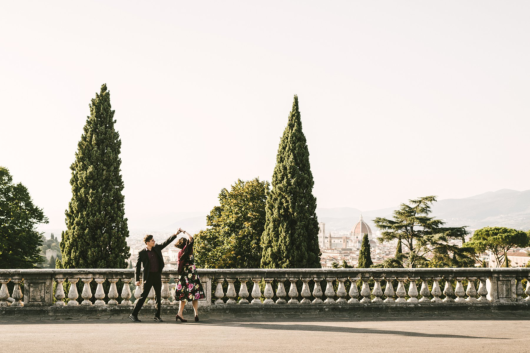 Let your engagement photographer guide you. Engagement pictures are usually romantic, but they do their best work when they turn out to be also fun and creative. Take those photos at sunset in a charming city like Florence and you will reach perfection