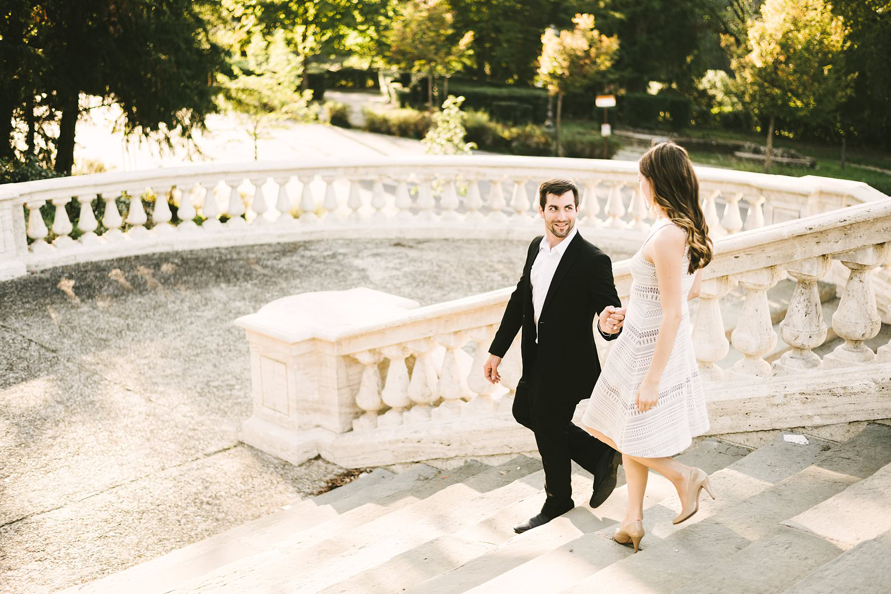 Engagement photos in Florence: so romantic! Kaitlyn and Marshall chose Florence for their engagement photos – and holiday! – and they came all the way from Missouri to personally experience the allure of the city. Couple walk down San Miniato staircase for a candid but lovely engagement photo during the golden hour