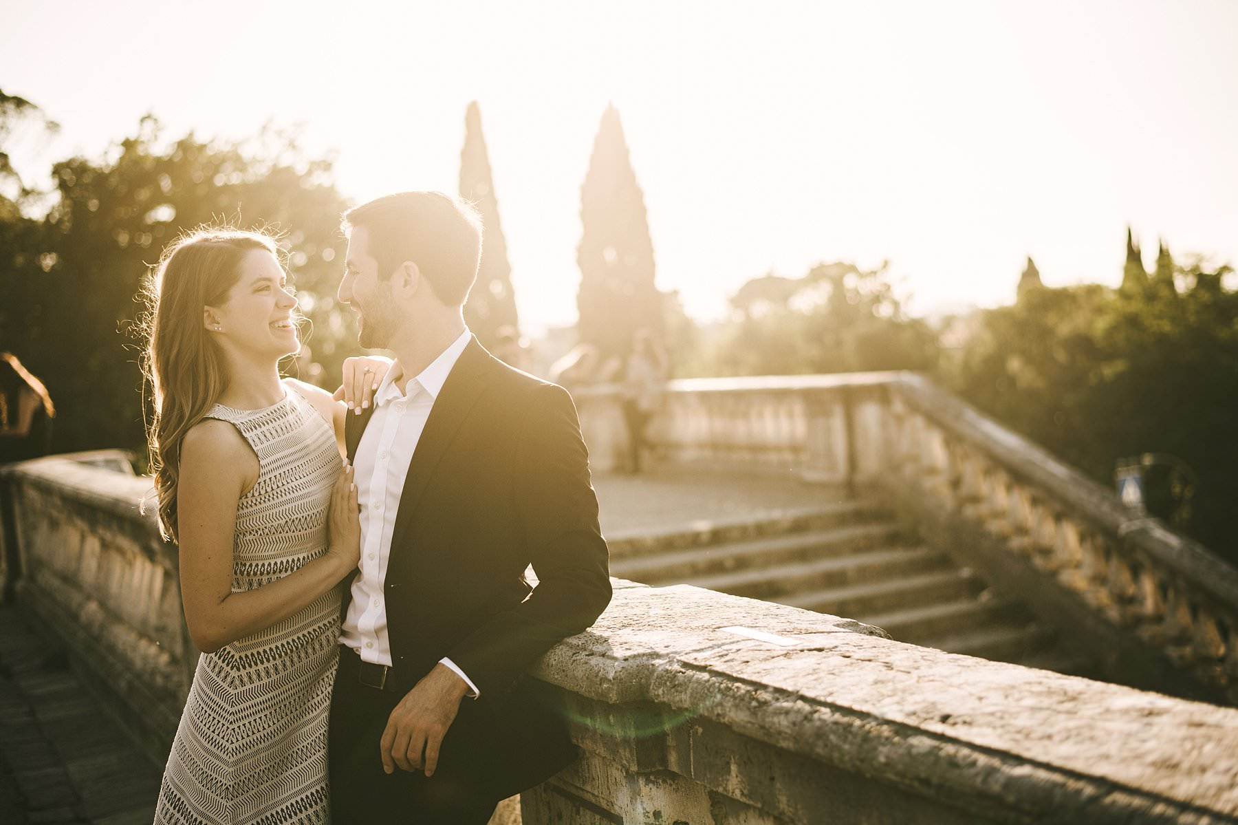 A sunset photoshoot to cherish your engagement forever. Some moments in life deserve to be celebrated in a special way. A way that makes them even more unique and unforgettable. That's the case of a birth, a family milestone, a wedding, or an engagement. And what's better than a sunset photoshoot in an incredible city like Florence, to honor such an occasion? Considered the cradle of the Renaissance, Florence is full of fascinating spots that work perfectly as settings for a sunset photoshoot. Its very heart, where white marble statues give way to wooden portals and to the intricately decorated façades of historic churches, welcomed the couple for a series of shots filled with smiles and emotions