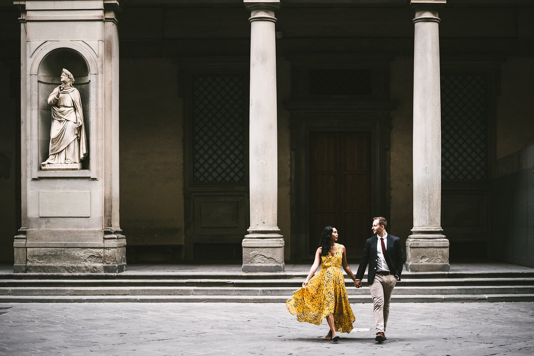 Angela and Max's surprise marriage proposal followed by a sweet engagement photoshoot in Florence! We snapped pictures all around the heart of the city, starting from the surroundings of San Miniato al Monte itself and continuing to Ponte Vecchio, Palazzo Vecchio and Uffizi Gallery. The warm light of the day matched perfectly with the color of Angela's dress, and with the bright smile of both these guys. This is surely a holiday they will remember forever, don't you think? If you're considering the idea of a surprise marriage proposal too, don't hesitate to contact me: I will be able to help you make the event truly unforgettable