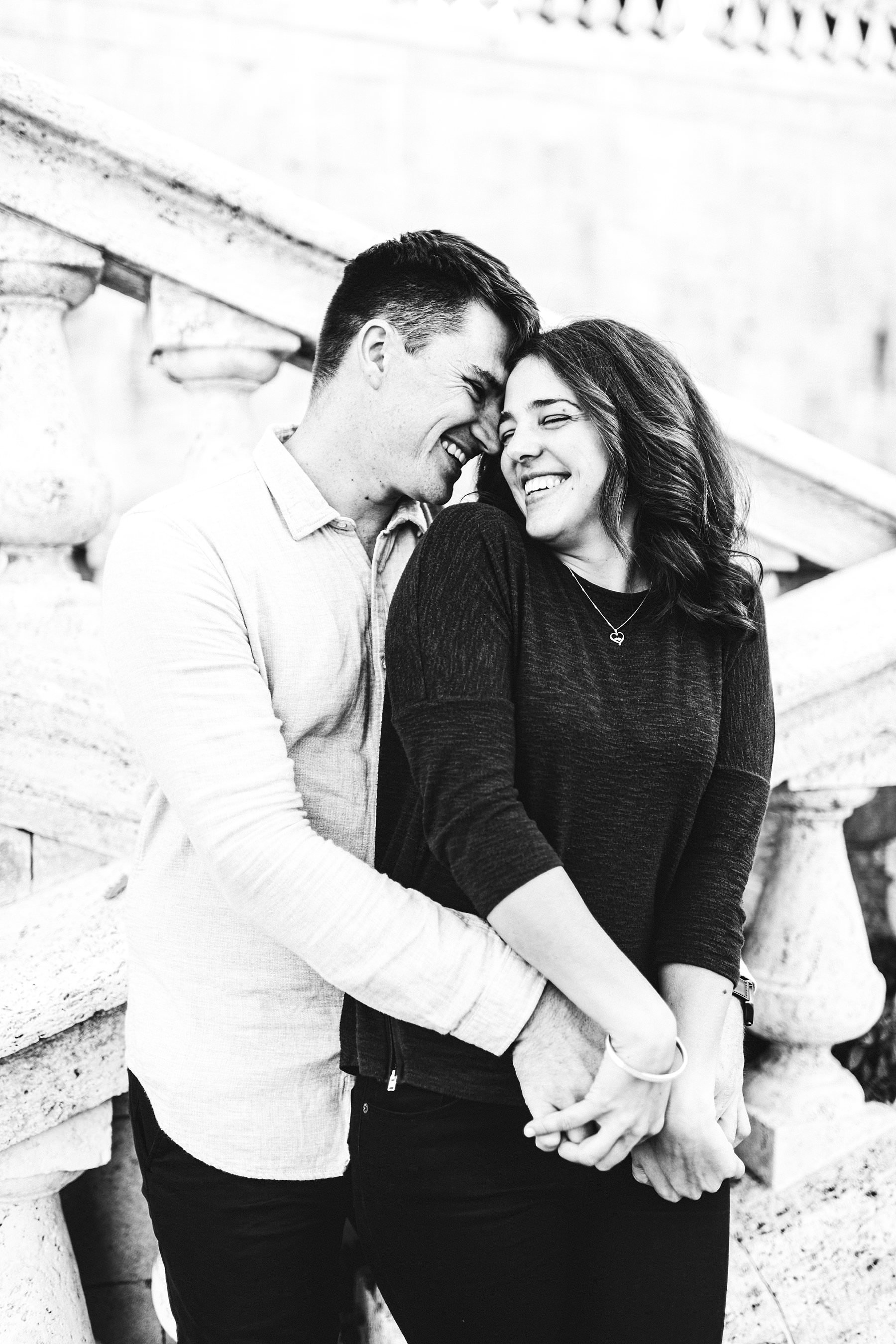 Another exciting genuine and smiling couple portrait photo during the engagement photo tour in Florence during a unique Christmas holiday