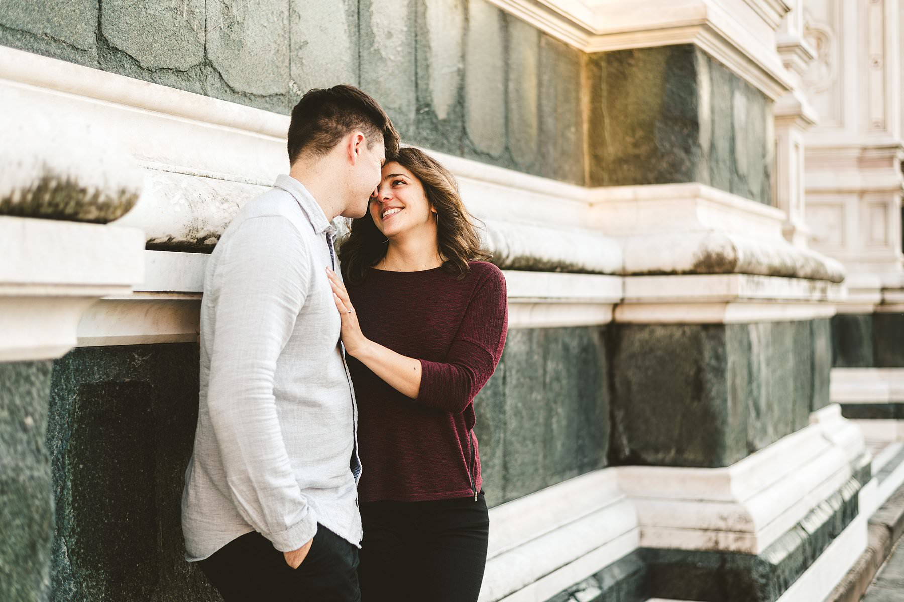 Claudia and Andrew's exciting and smiling engagement photo session at Piazza Santa Croce in the heart of Florence. Enjoy your walk photo tour in the Cradle of Renaissance and build your memories to cherish forever