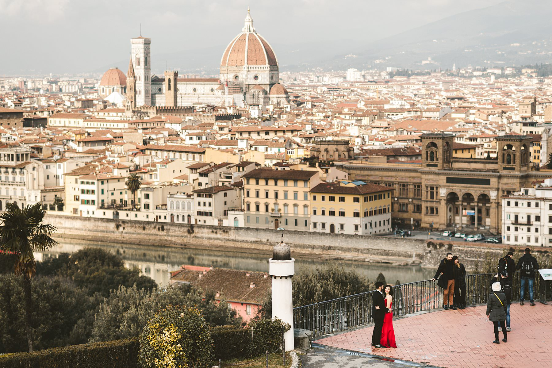 Unforgettable winter engagement pre-wedding photo session in the most iconic panoramic spot of Florence, Piazzale Michelangelo