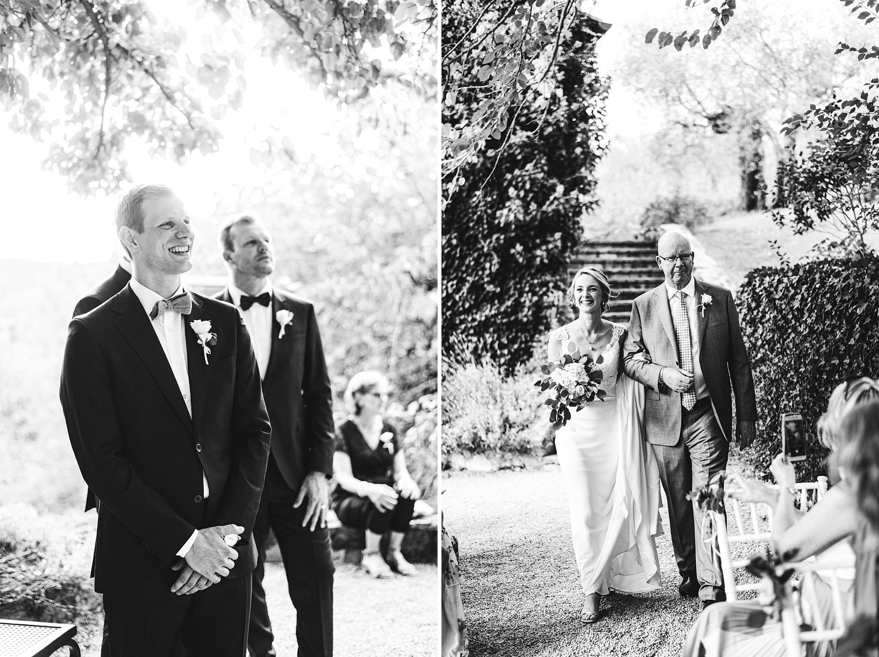 A special international wedding in the countryside of Umbria, Italy. Elegant Australian bride Jennifer walks with father in the symbolic ceremony held in a courtyard close to the Villa Monte Solare, surrounded by greenery and decorated with delicate flowers
