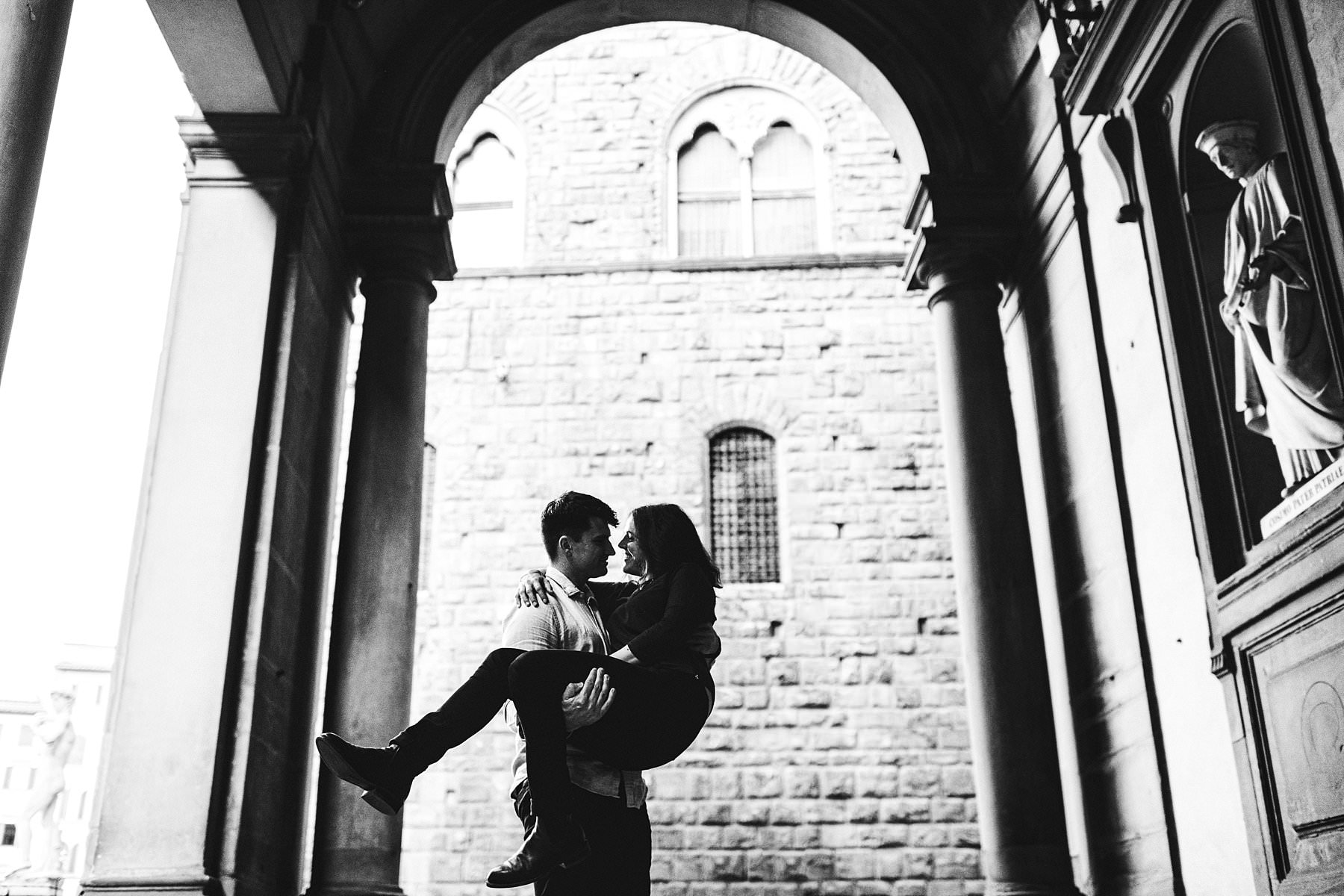 Claudia and Andrew's exciting and fun engagement photos. Lovely couple portrait at Uffizi art Gallery near Palazzo Vecchio