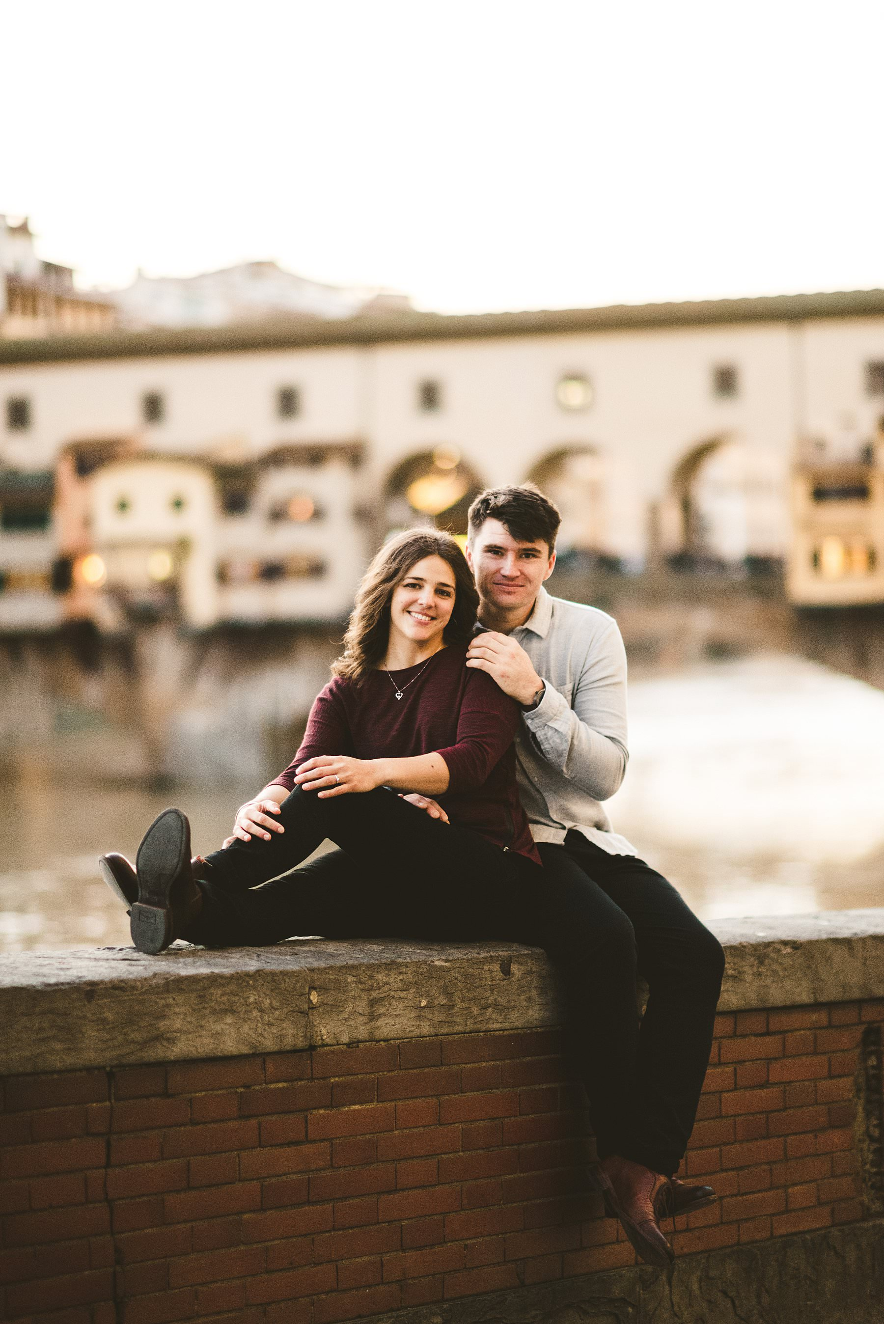 Traditional engagement couple portrait in one of the most beautiful location of Florence near Ponte Vecchio in the heart of the city