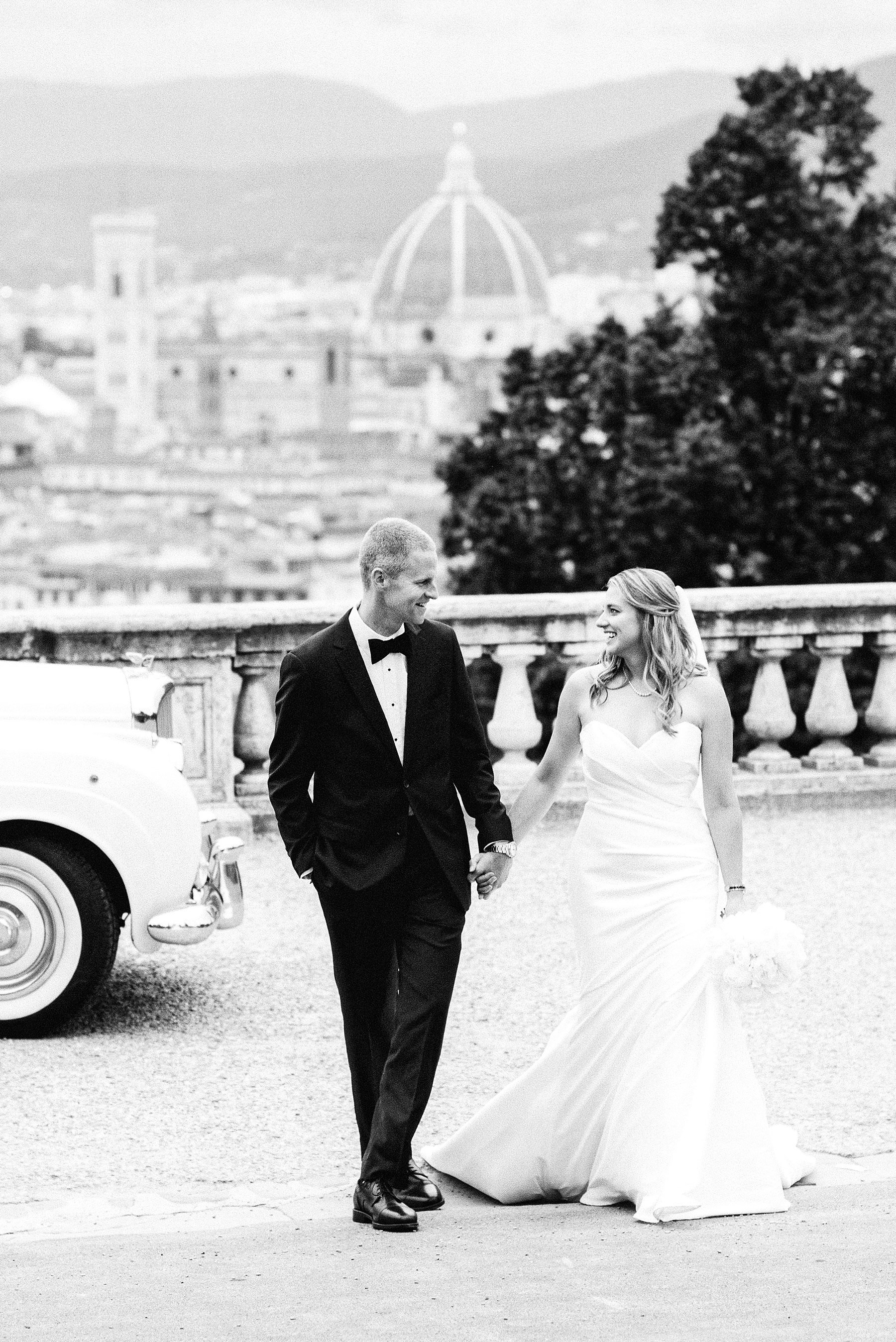 Beth and Evan's exquisite wedding: just like a dream. Bride and groom portraits in the most iconic and fascinating spots of the city of Florence, such as the breathtaking San Miniato al Monte and the romantic Ponte Vecchio