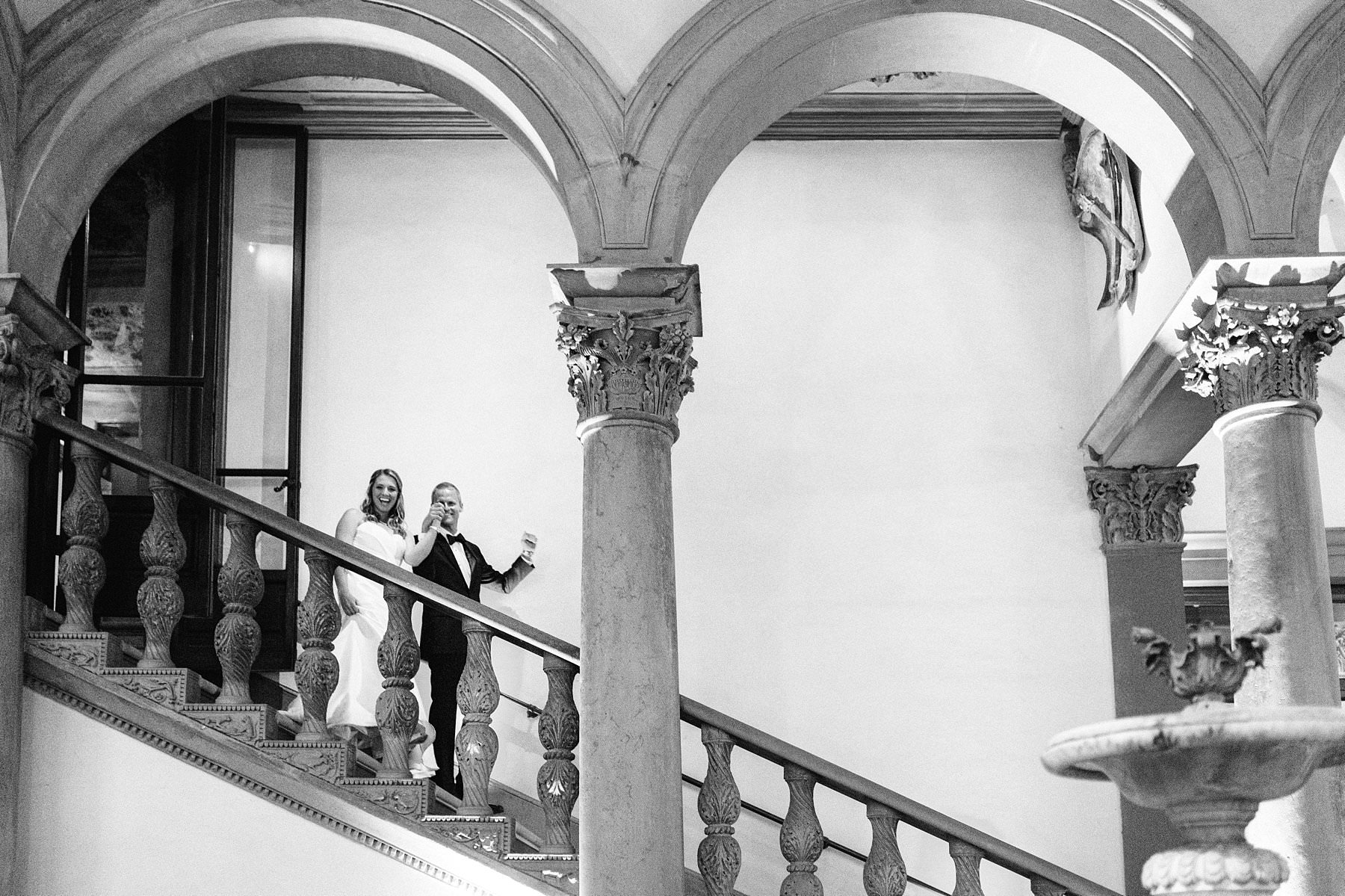 Bride and groom walk in the dinner reception at Palazzo Gondi one of the best wedding venue in the very heart of Florence