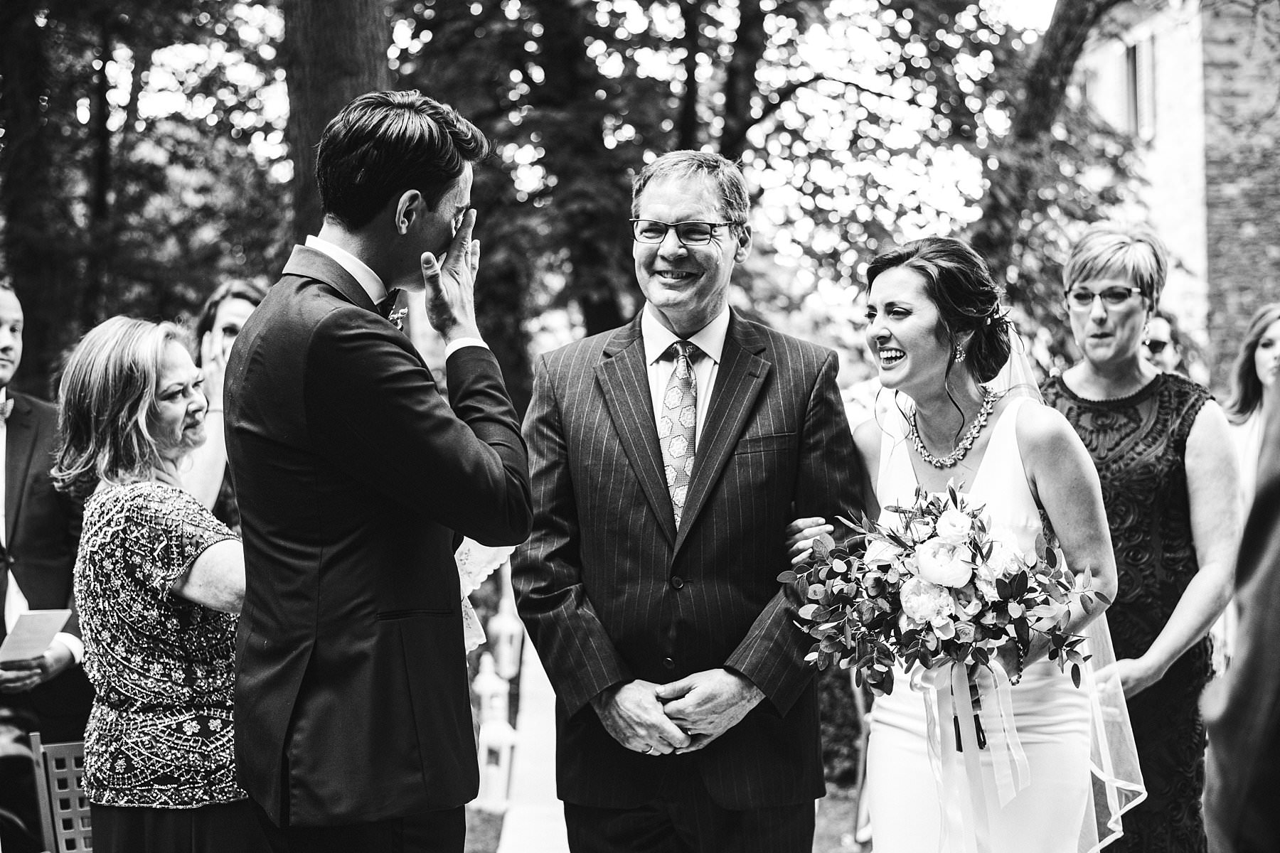 Katrina and John's small wedding in Valdarno. Emotional moment during bride walks in the outdoor symbolic wedding ceremony at Palazzo Vanneschi in the countryside of Tuscany near Bucine