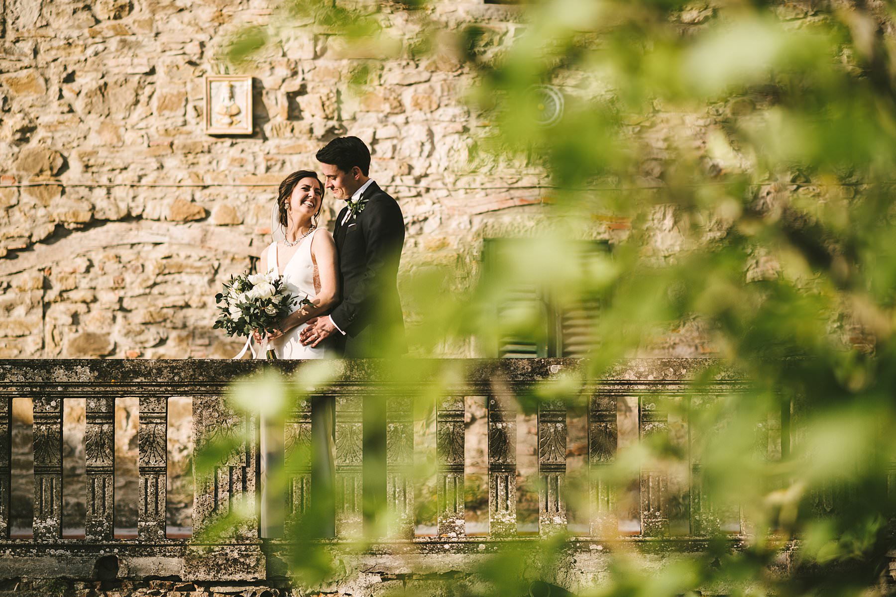 Heartfelt small wedding in the countryside of Tuscany. Beautiful and elegant bride and groom wedding portrait at Palazzo Vanneschi in Bucine