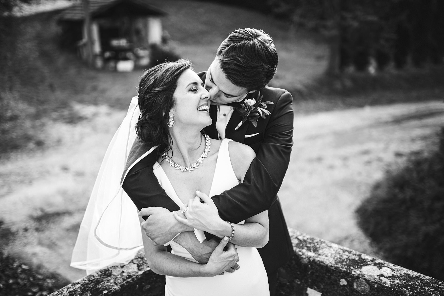 Heartfelt small wedding in the countryside of Tuscany. Beautiful, elegant and exciting bride and groom wedding portrait at Palazzo Vanneschi in Bucine