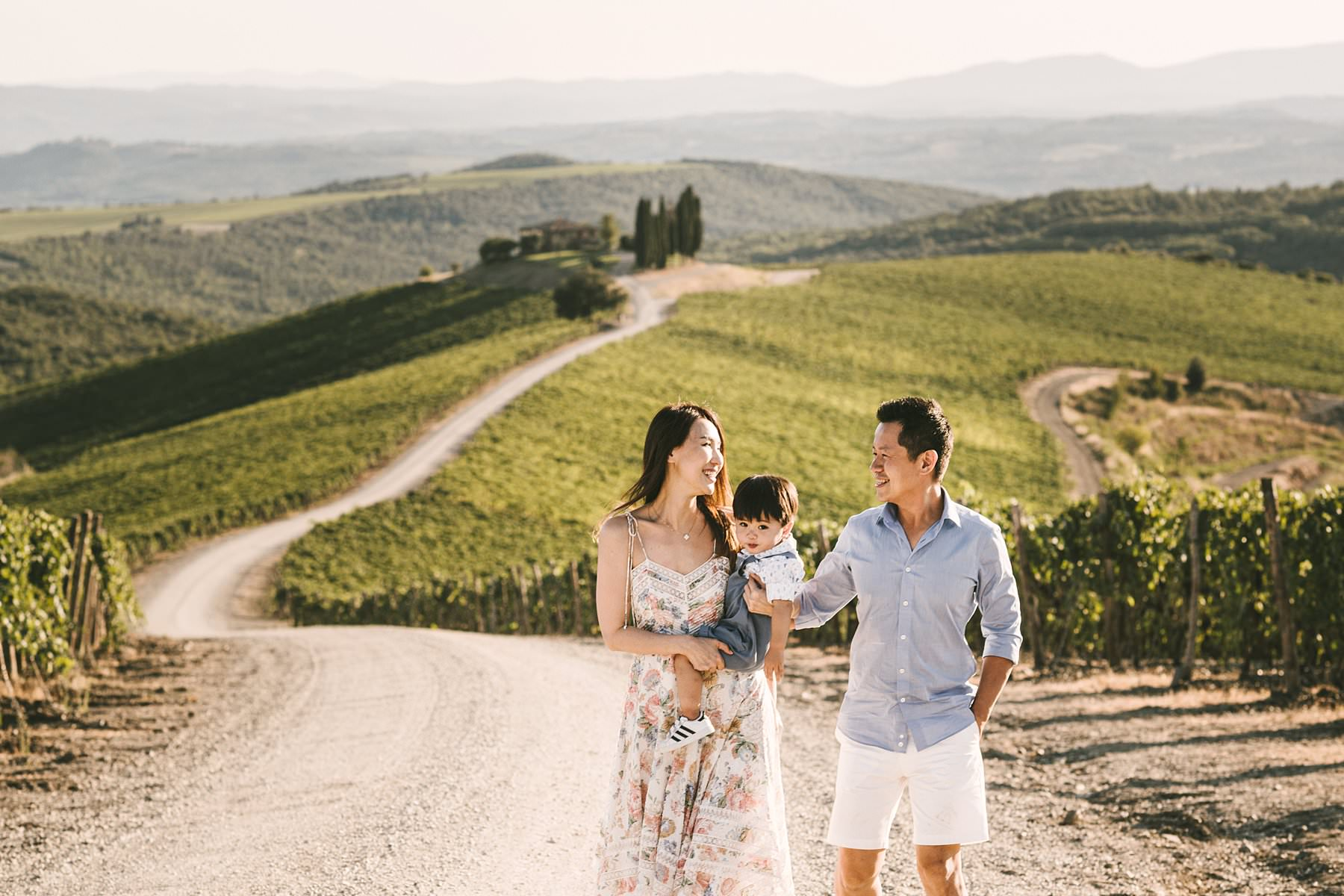 The marvelous vineyard of Rosewood Castiglion del Bosco. Serena and Kelvin, wife and husband from Singapore, chose Tuscany as the destination of a relaxing holiday with their littlest love: their son. Since he was so young, they decided to contact me for a family holiday photoshoot so that the memory of those days would live forever – for all of them. We met at the location where they were staying, Rosewood Castiglion del Bosco, and I guided them through a simple but meaningful photo session. When one of the protagonists is so young, it can be tricky to keep him focused and entertained throughout the shooting: that's why is always better to hire an experienced photographer