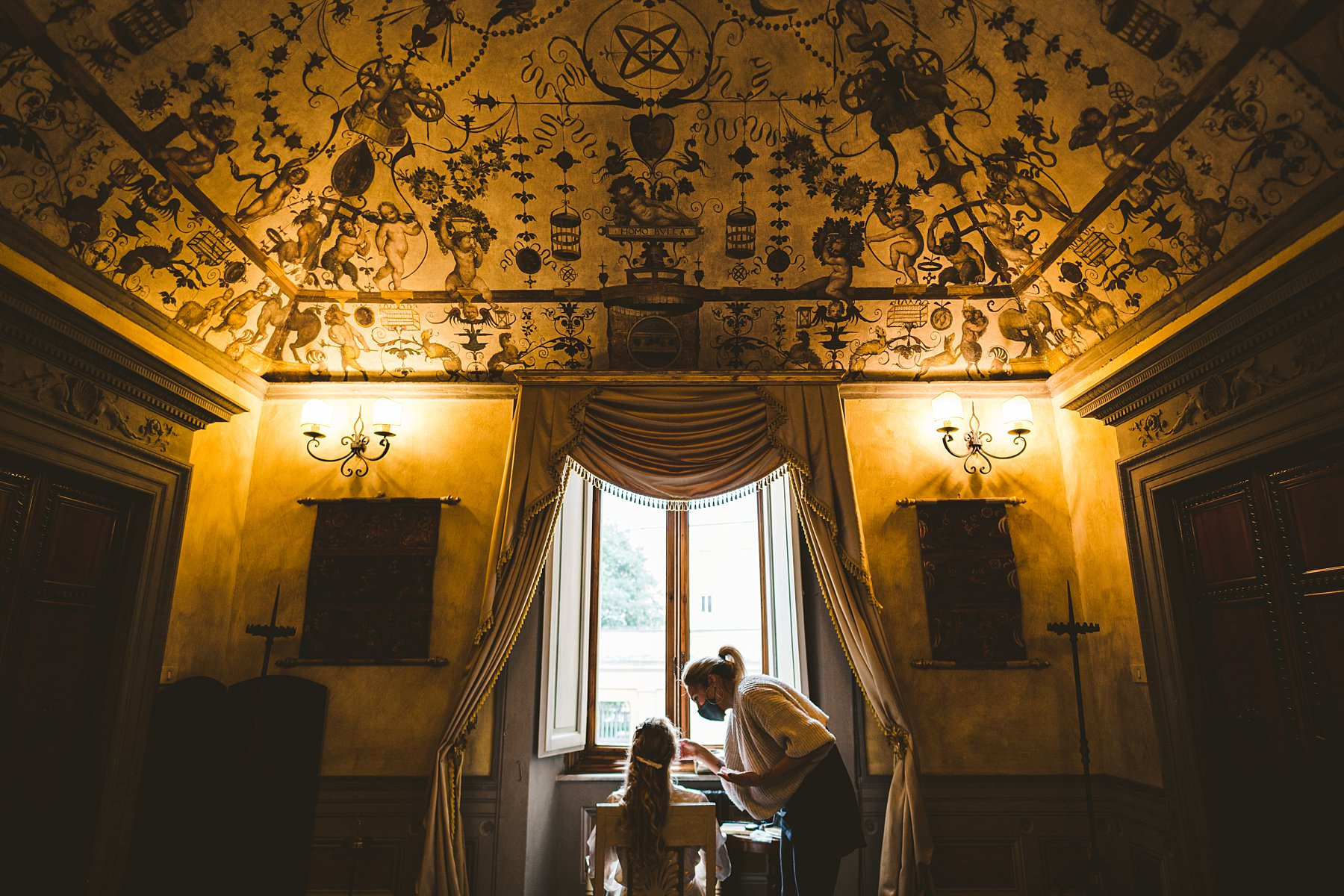 Bride getting ready at Palazzo Coli Bizzarrini in the heart of Siena, an historic residence whose architecture and incredible frescoes take you back to the Renaissance