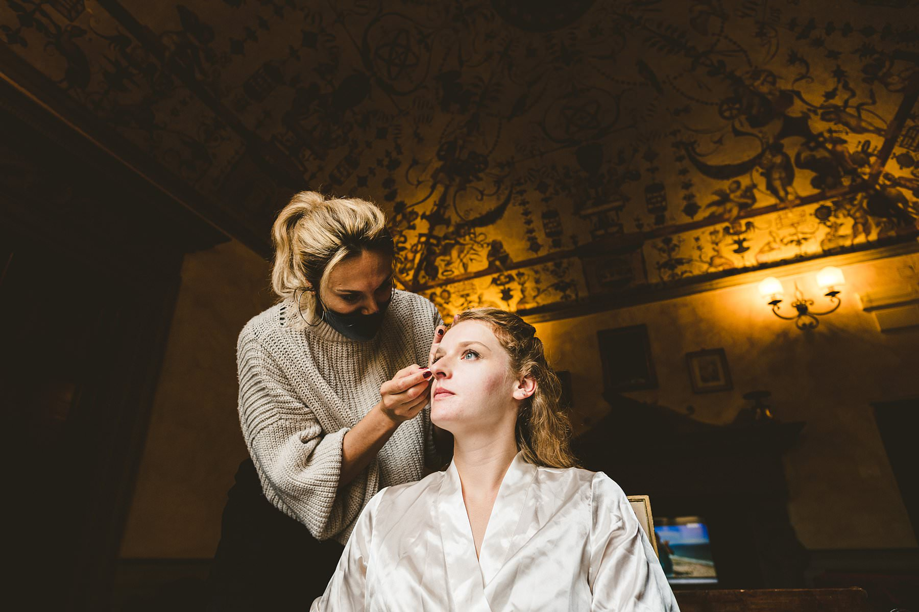 Beautiful bride Poppy get ready at Palazzo Coli Bizzarrini in the heart of Siena, an historic residence whose architecture and incredible frescoes take you back to the Renaissance