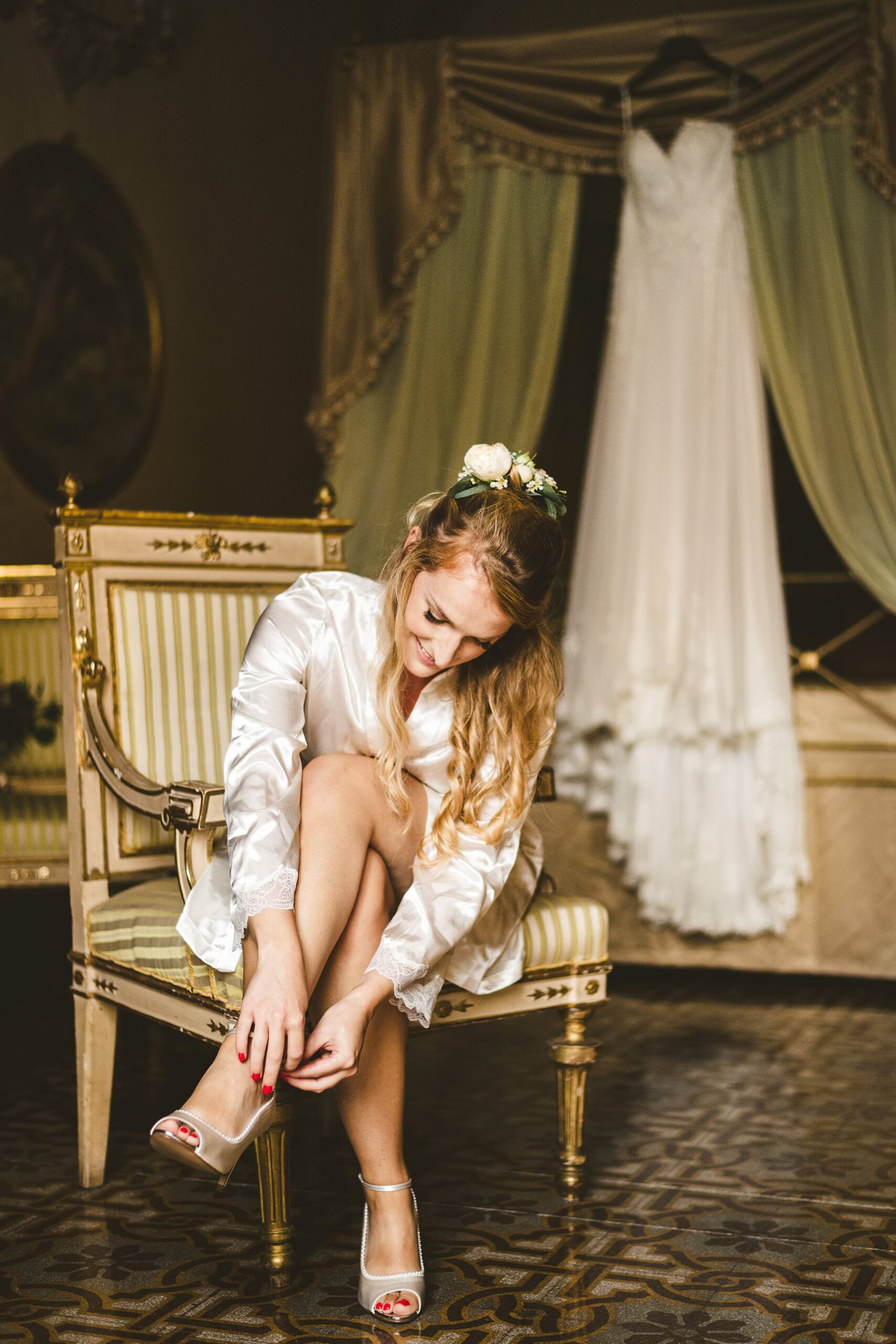 Beautiful bride Poppy almost ready to wear her wedding gown at Palazzo Coli Bizzarrini in the heart of Siena