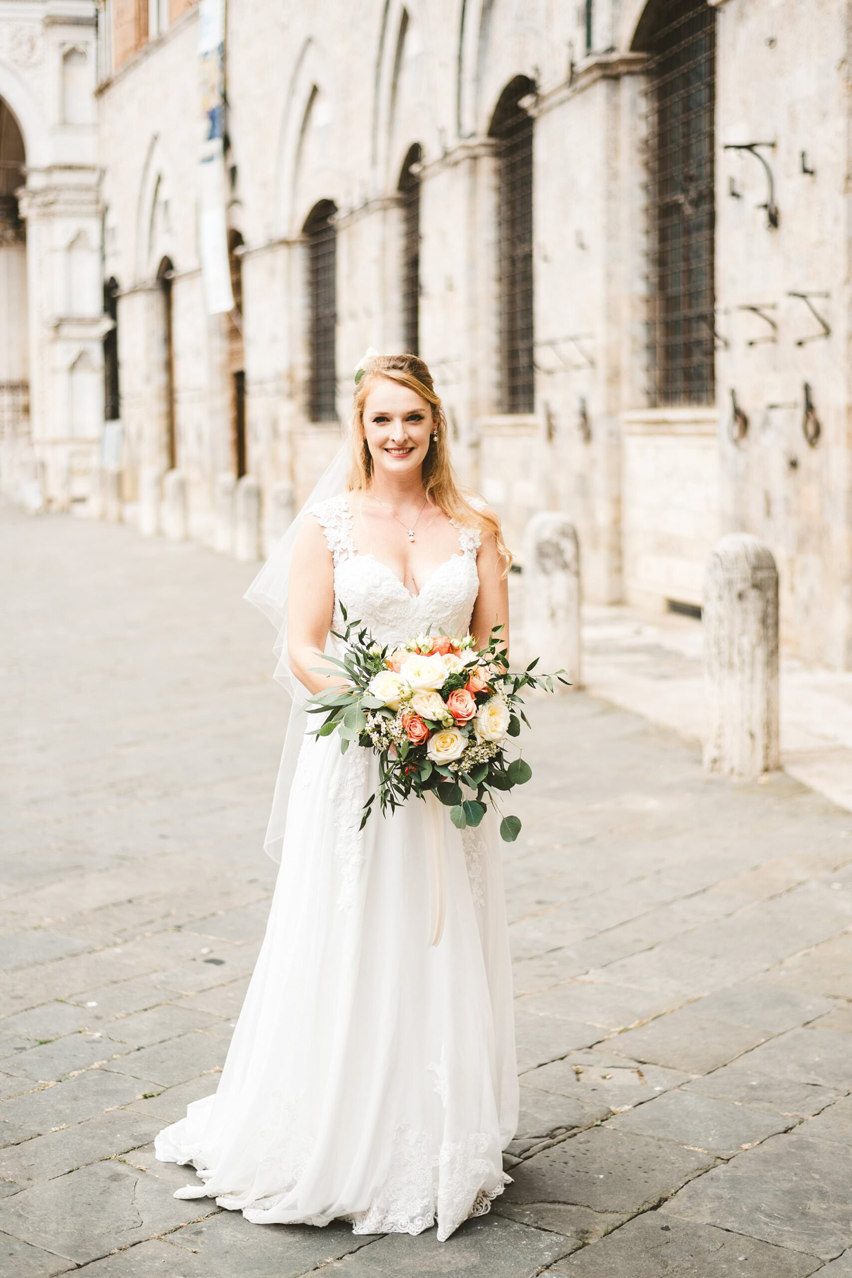 Beautiful bride Poppy from Uk almost ready to walks down the aisle in the Concistoro room in Siena Town hall